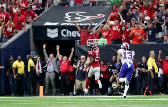 Oct 14, 2018; Houston, TX, USA; Houston Texans cornerback Johnathan Joseph (24) intercepts a ball and runs in for a touchdown  during the fourth quarter against the Buffalo Bills at NRG Stadium. Mandatory Credit: Kevin Jairaj-USA TODAY Sports