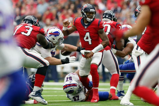 Kyle Williams #95 of the Buffalo Bills strips the ball from Deshaun Watson #4 of the Houston Texans in the second half at NRG Stadium on October 14, 2018 in Houston, Texas.