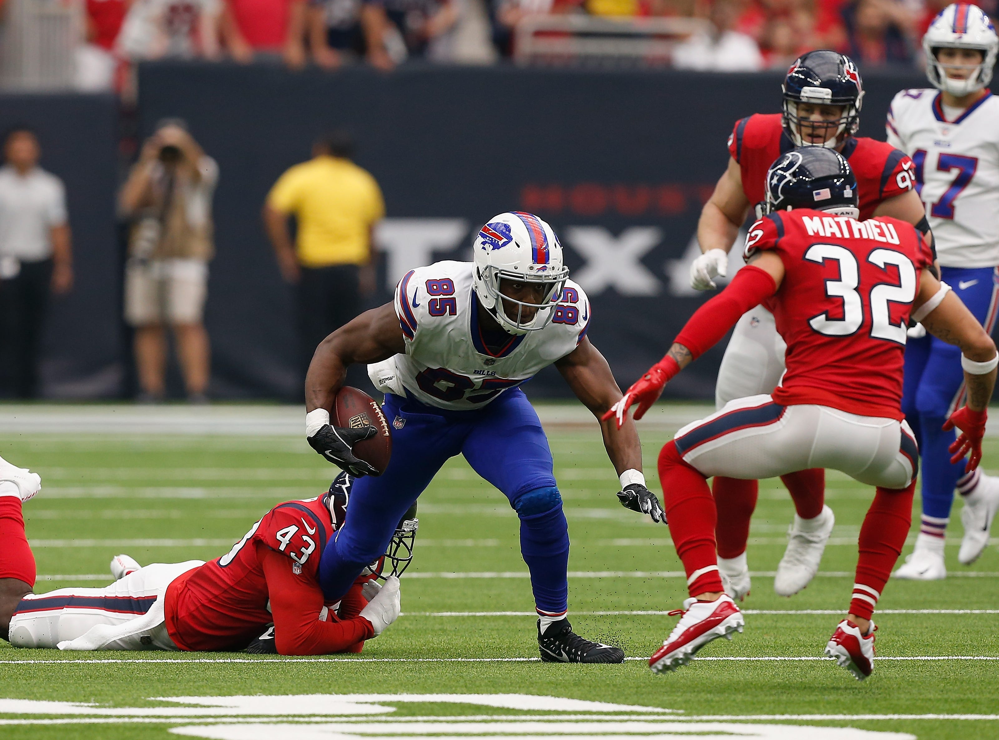 HOUSTON, TX - OCTOBER 14:  Charles Clay #85 of the Buffalo Bills runs the ball after a catch tackled by Shareece Wright #43 and Tyrann Mathieu #32 of the Houston Texans in the second quarter at NRG Stadium on October 14, 2018 in Houston, Texas.  (Photo by Bob Levey/Getty Images)