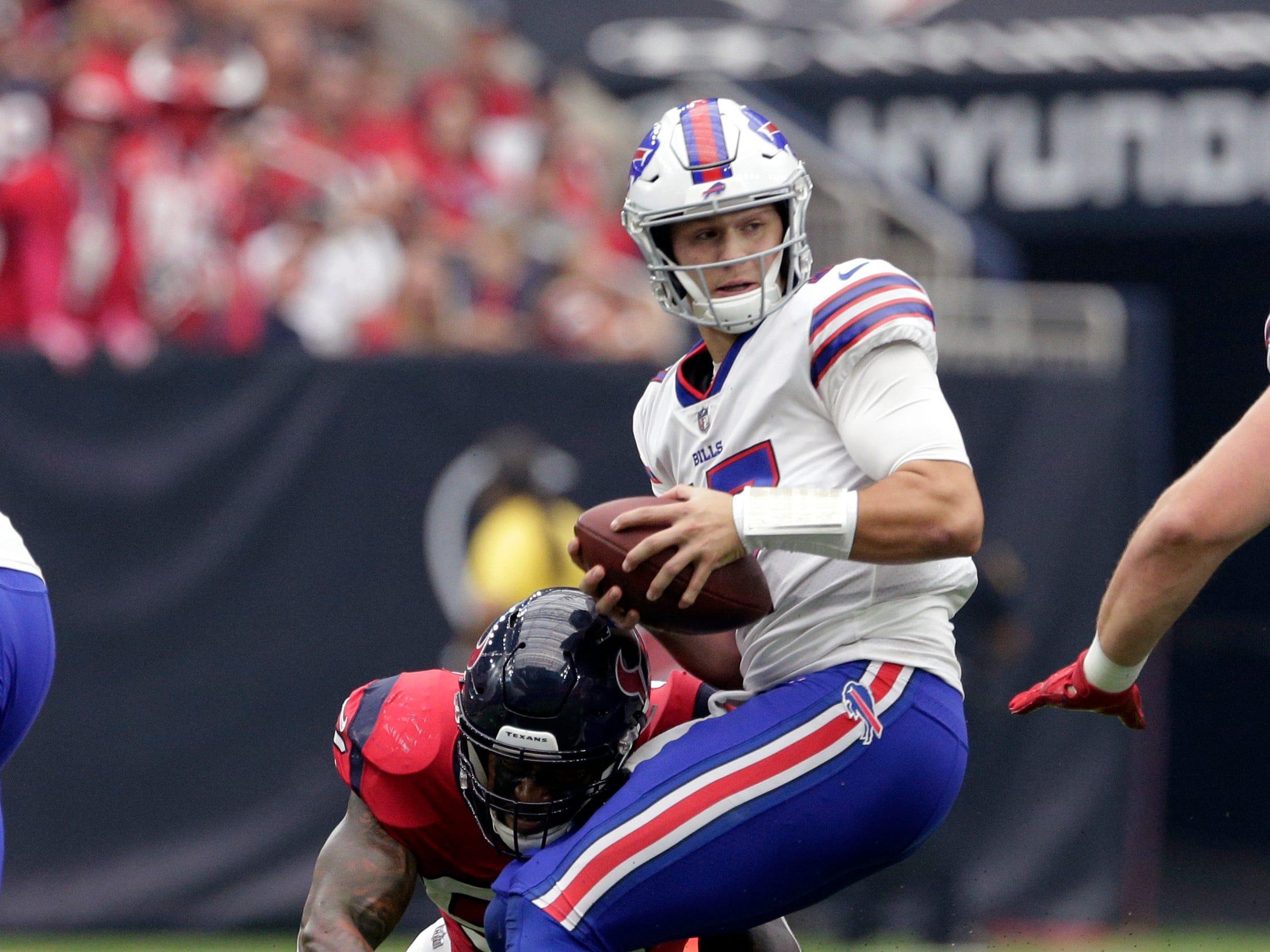 Buffalo Bills quarterback Josh Allen (17) is hit by Houston Texans linebacker Benardrick McKinney (55) during the first quarter of an NFL football game, Sunday, Oct. 14, 2018, in Houston. (AP Photo/Michael Wyke)