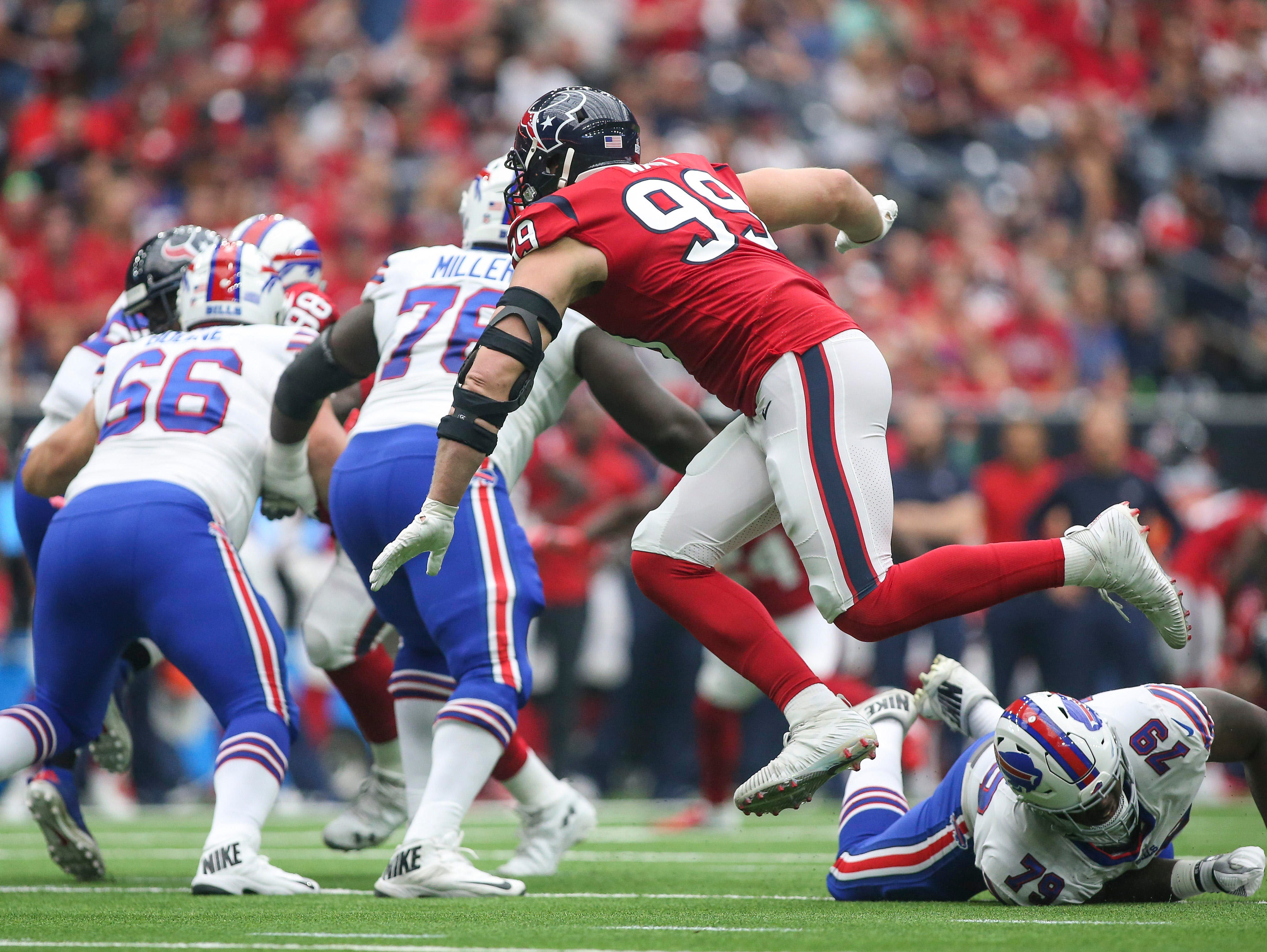 Oct 14, 2018; Houston, TX, USA; Houston Texans defensive end J.J. Watt (99) leaps as he applies defensive pressure during the first quarter against the Buffalo Bills at NRG Stadium. Mandatory Credit: Troy Taormina-USA TODAY Sports