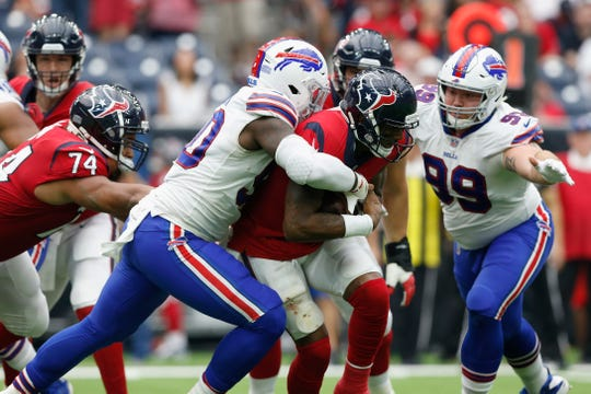 Shaq Lawson of the Buffalo Bills sacks Deshaun Watsonof the Houston Texans in the second half at NRG Stadium last Sunday.