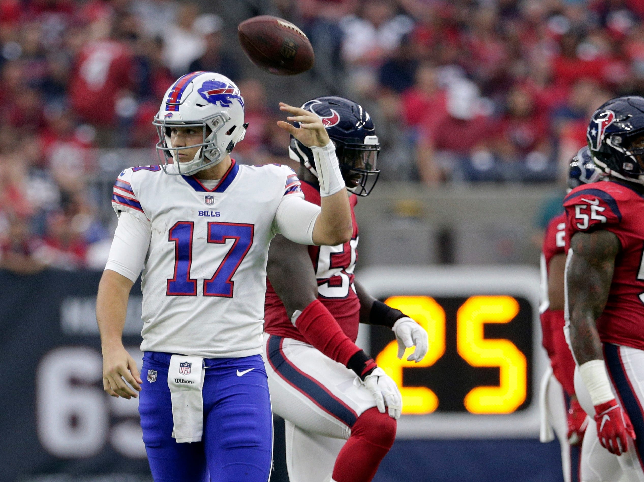 Buffalo Bills quarterback Josh Allen (17) tosses the ball back after he was sacked during the first half of an NFL football game against the Houston Texans, Sunday, Oct. 14, 2018, in Houston. (AP Photo/Michael Wyke)