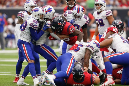 HOUSTON, TX - OCTOBER 14:  Alfred Blue #28 of the Houston Texans rushes the ball tackled by Tremaine Edmunds #49 of the Buffalo Bills in the second quarter at NRG Stadium on October 14, 2018 in Houston, Texas.  (Photo by Bob Levey/Getty Images)