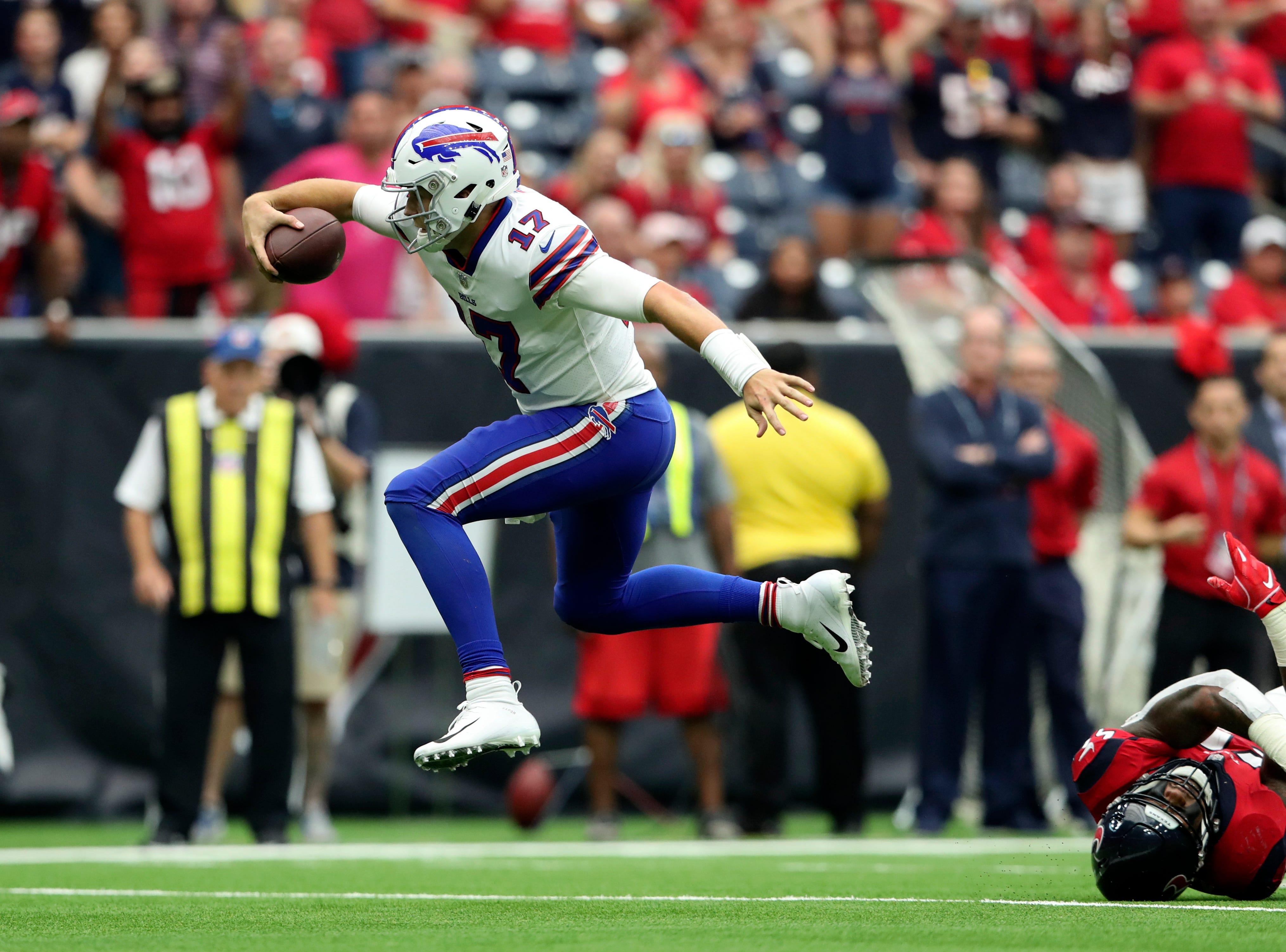Oct 14, 2018; Houston, TX, USA; Buffalo Bills quarterback Josh Allen (17) jumps during the second half while running against the Houston Texans at NRG Stadium. Mandatory Credit: Kevin Jairaj-USA TODAY Sports