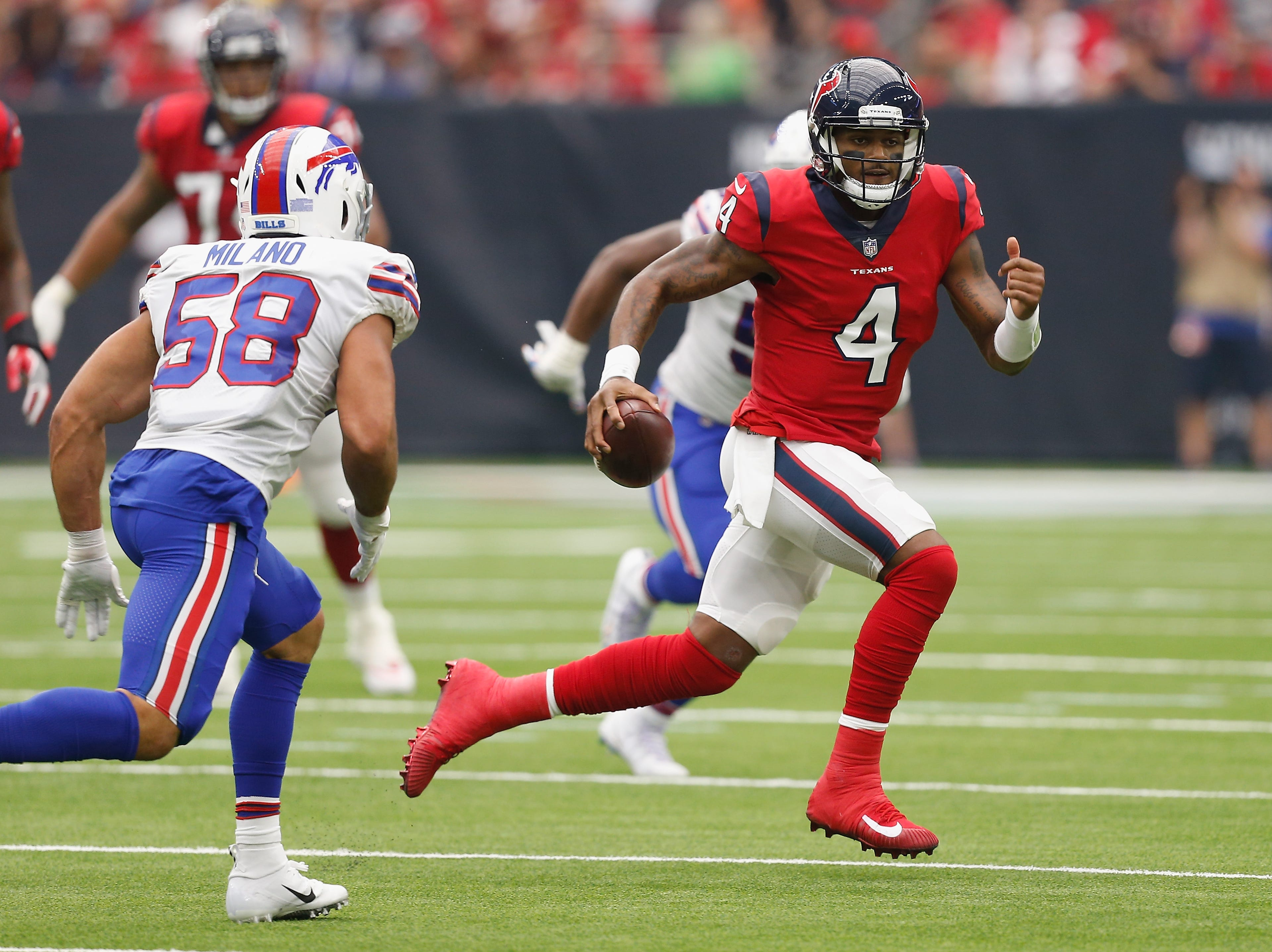 HOUSTON, TX - OCTOBER 14:  Deshaun Watson #4 of the Houston Texans scrambles pressured by Matt Milano #58 of the Buffalo Bills in the second quarter at NRG Stadium on October 14, 2018 in Houston, Texas.  (Photo by Bob Levey/Getty Images)
