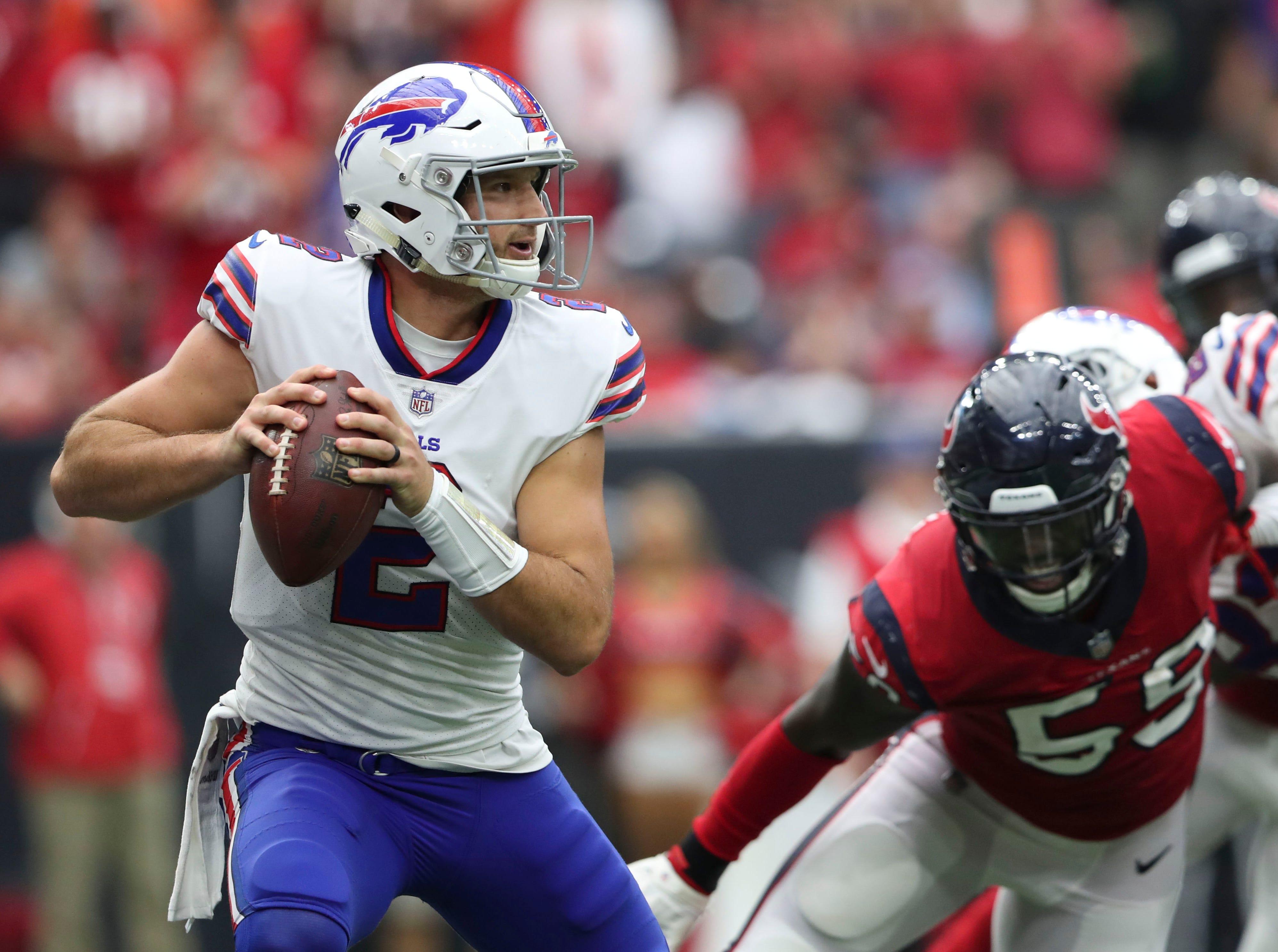 Oct 14, 2018; Houston, TX, USA; Buffalo Bills quarterback Nathan Peterman (2) throws as Houston Texans linebacker Whitney Mercilus (59) chases him during the second half at NRG Stadium. Mandatory Credit: Kevin Jairaj-USA TODAY Sports