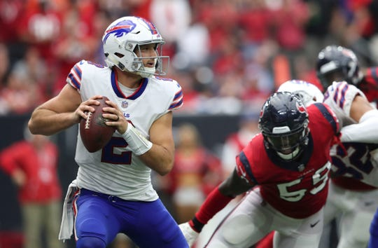 Oct 14, 2018; Houston, TX, USA; Buffalo Bills quarterback Nathan Peterman (2) throws as Houston Texans linebacker Whitney Mercilus (59) chases him during the second half at NRG Stadium. Mandatory Credit: Kevin Jairaj-USA TODAY Sports