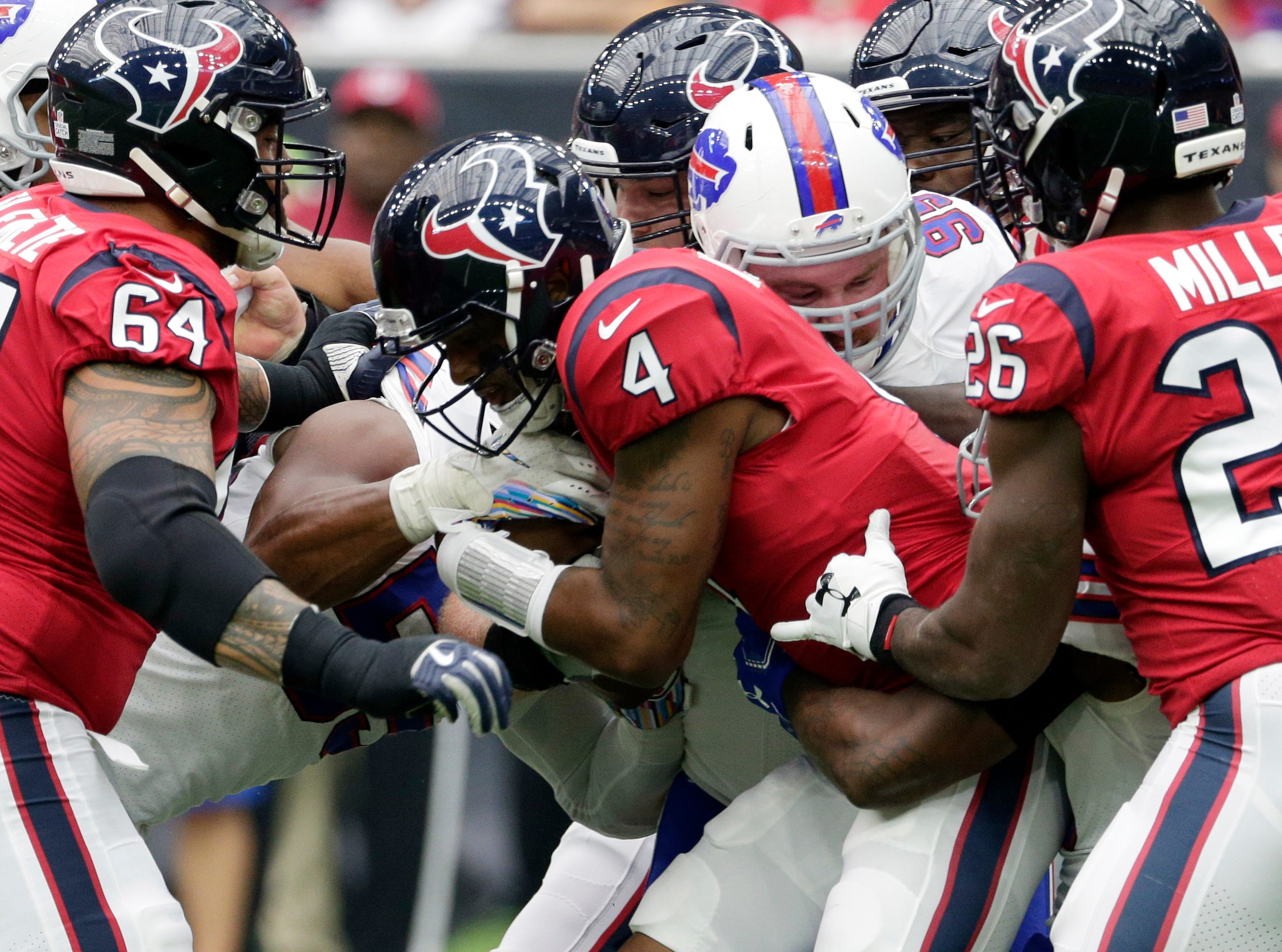 Houston Texans quarterback Deshaun Watson (4) is hit by Buffalo Bills defensive tackle Kyle Williams (95) during the first quarter of an NFL football game, Sunday, Oct. 14, 2018, in Houston. (AP Photo/Michael Wyke)