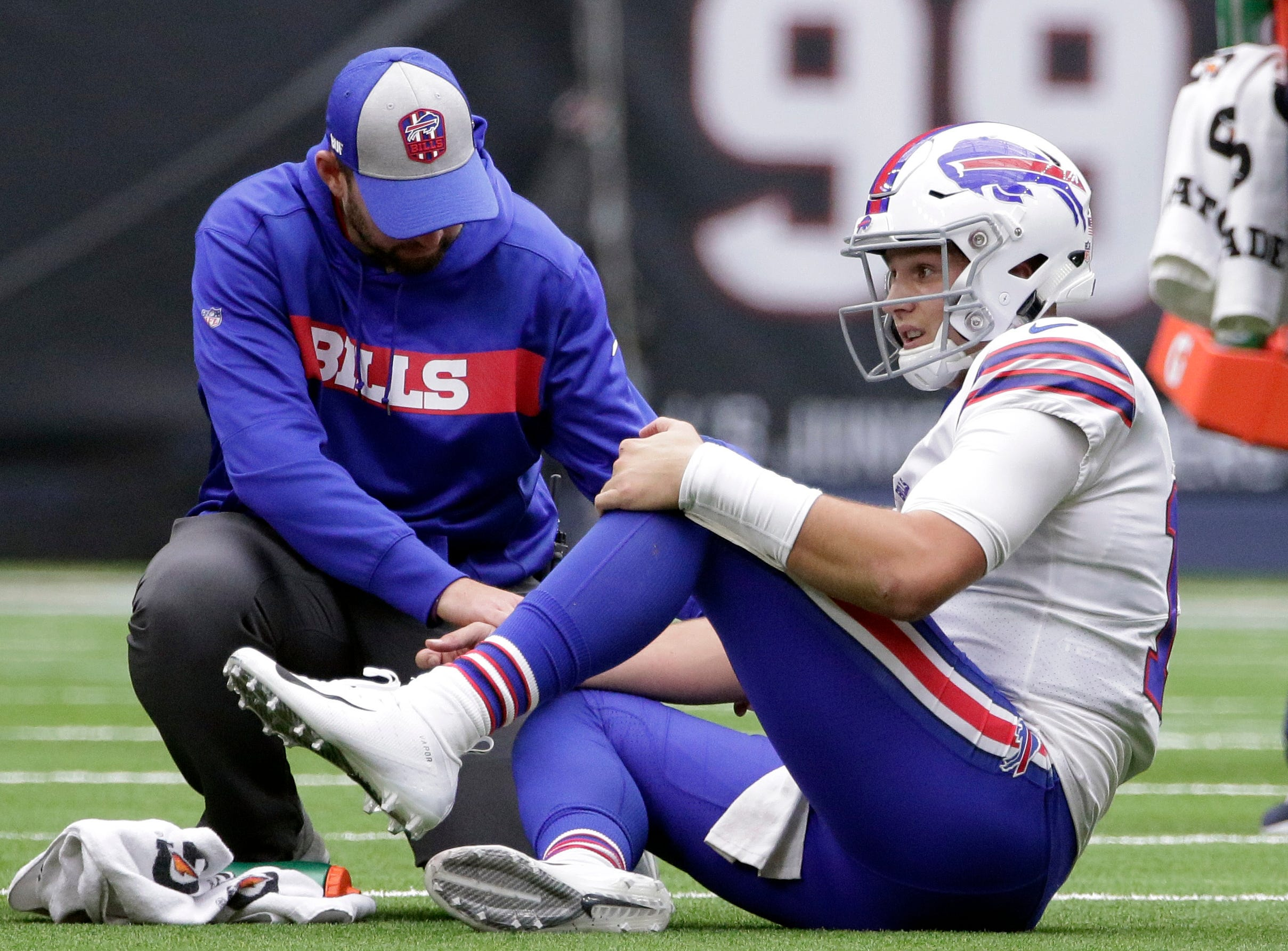 Buffalo Bills quarterback Josh Allen (17) is checked on after he was injured during the second half of an NFL football game against the Houston Texans, Sunday, Oct. 14, 2018, in Houston. (AP Photo/Michael Wyke)