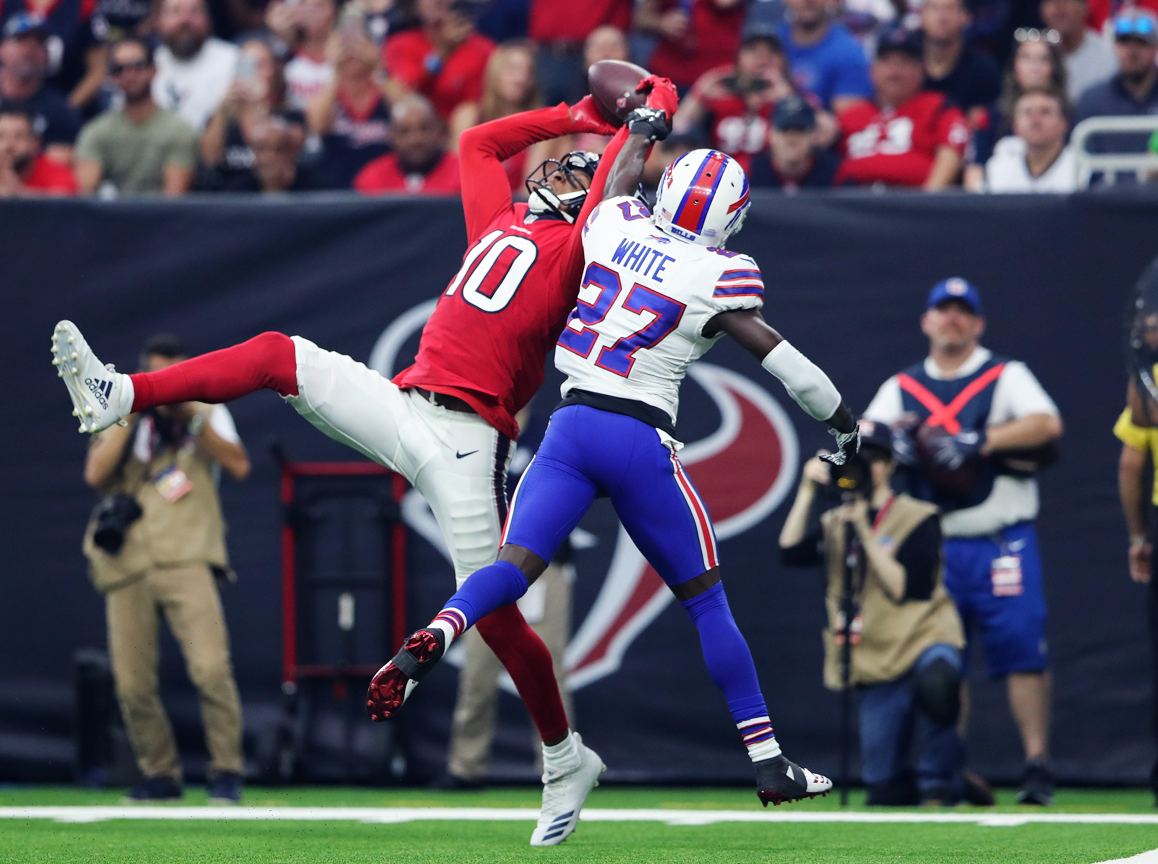 Oct 14, 2018; Houston, TX, USA; Houston Texans wide receiver DeAndre Hopkins (10) catches a touchdown  pass as Buffalo Bills cornerback Tre'Davious White (27) defends during the first quarter at NRG Stadium. Mandatory Credit: Kevin Jairaj-USA TODAY Sports