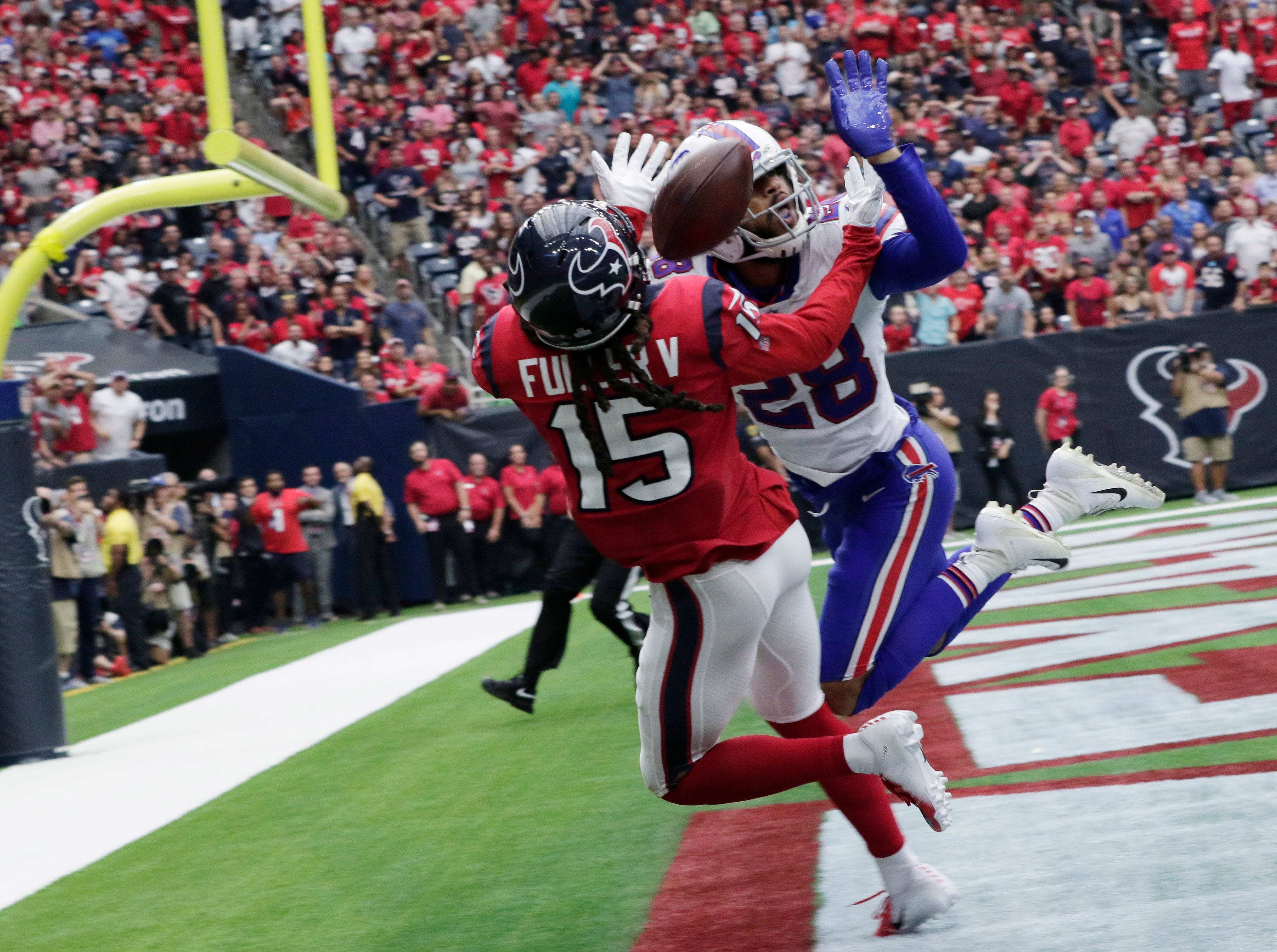Buffalo Bills defensive back Phillip Gaines (28) breaks up a pass intended for Houston Texans wide receiver Will Fuller (15) during the second half of an NFL football game, Sunday, Oct. 14, 2018, in Houston. Interference was called on the play. (AP Photo/Michael Wyke)