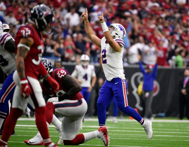 Buffalo Bills quarterback Nathan Peterman (2) celebrates his touchdown pass against the Houston Texans during the second half of an NFL football game, Sunday, Oct. 14, 2018, in Houston. (AP Photo/Eric Christian Smith)