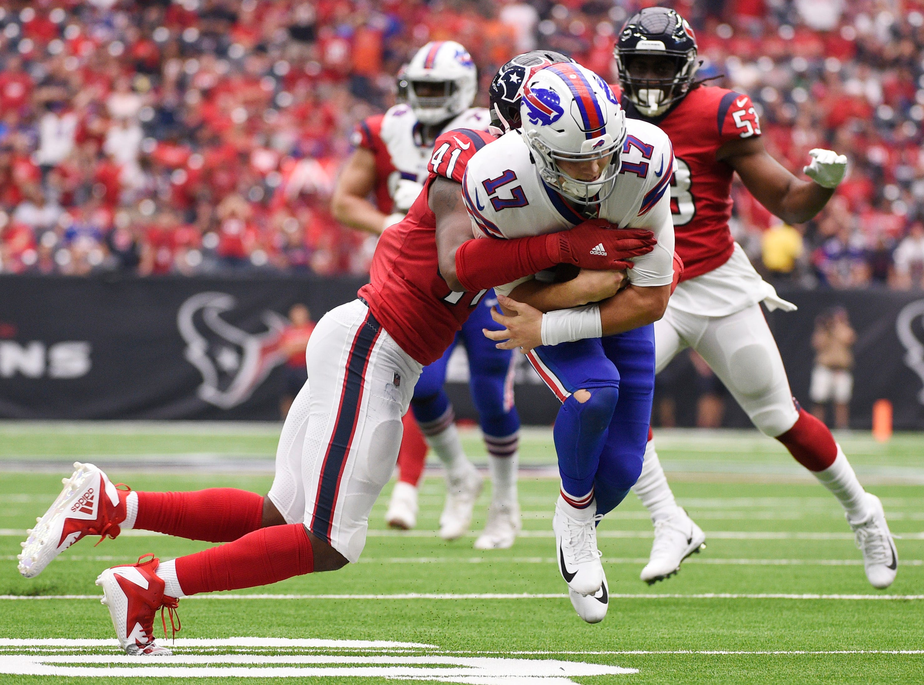 Buffalo Bills quarterback Josh Allen (17) is hit by Houston Texans linebacker Zach Cunningham (41) during the second half of an NFL football game, Sunday, Oct. 14, 2018, in Houston. (AP Photo/Eric Christian Smith)