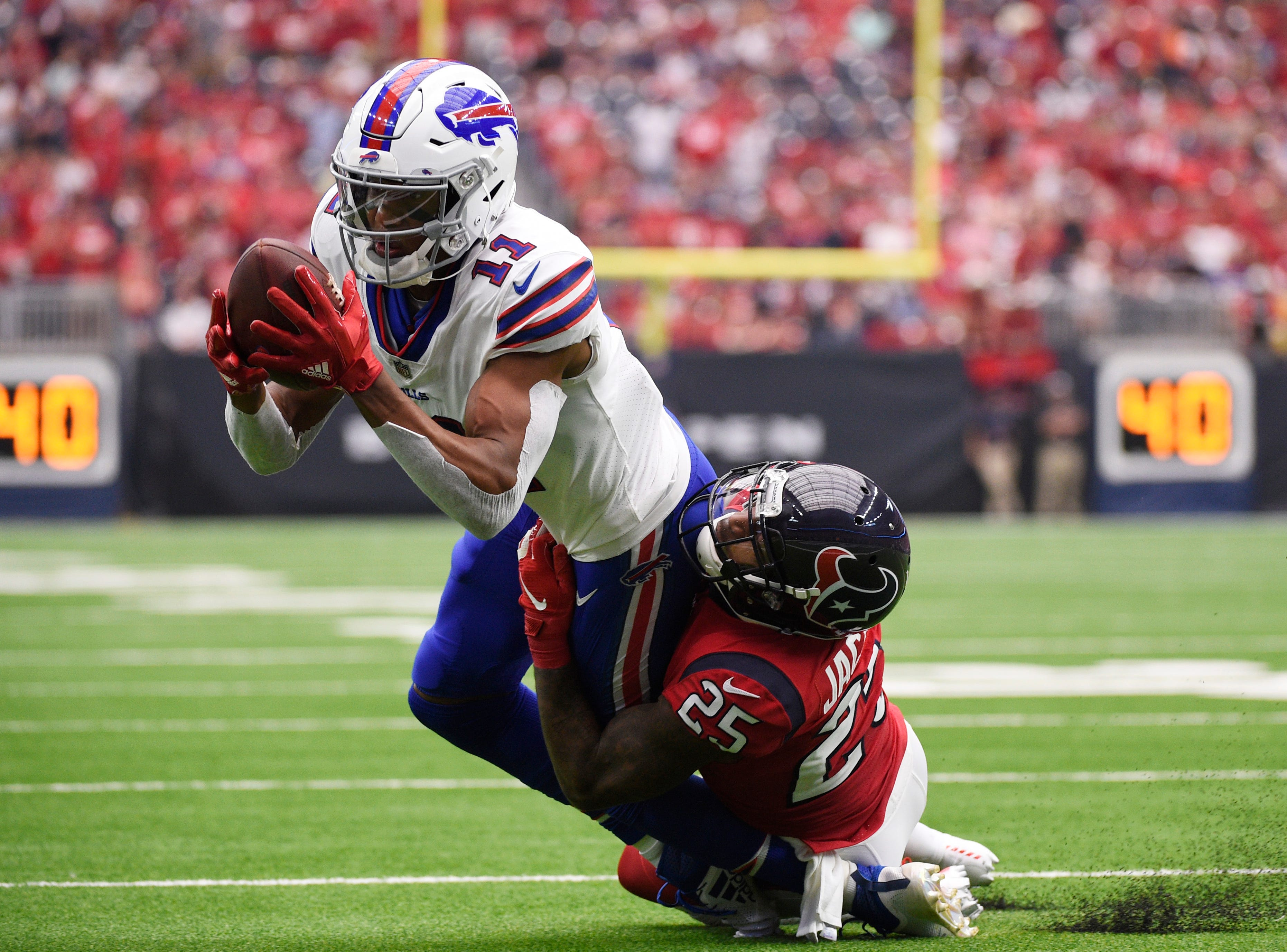 Buffalo Bills wide receiver Zay Jones (11) is hit by Houston Texans strong safety Kareem Jackson (25) after making a catch during the second half of an NFL football game, Sunday, Oct. 14, 2018, in Houston. (AP Photo/Eric Christian Smith)