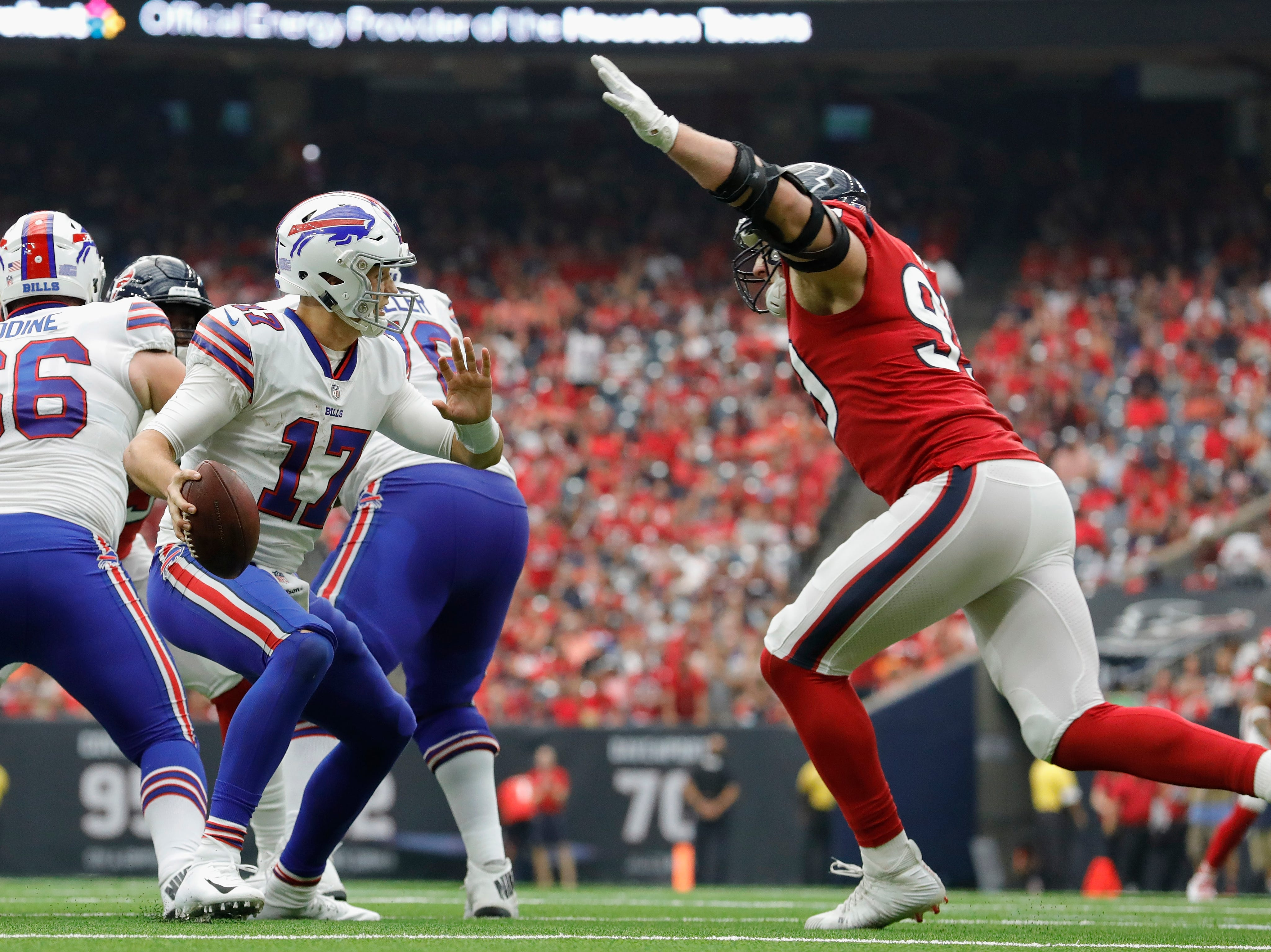 HOUSTON, TX - OCTOBER 14:  Josh Allen #17 of the Buffalo Bills is pressured by J.J. Watt #99 of the Houston Texans in the second half at NRG Stadium on October 14, 2018 in Houston, Texas.  (Photo by Tim Warner/Getty Images)