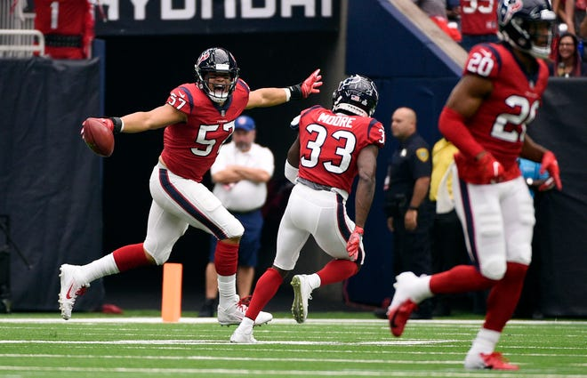 Houston Texans linebacker Brennan Scarlett (57) celebrates a fumble recovery against the Buffalo Bills during the first quarter of an NFL football game, Sunday, Oct. 14, 2018, in Houston. (AP Photo/Eric Christian Smith)