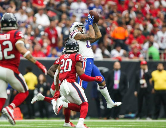 Oct 14, 2018; Houston, TX, USA; Buffalo Bills wide receiver Kelvin Benjamin (13) makes a reception as Houston Texans defensive back Justin Reid (20) defends during the third quarter at NRG Stadium. Mandatory Credit: Troy Taormina-USA TODAY Sports