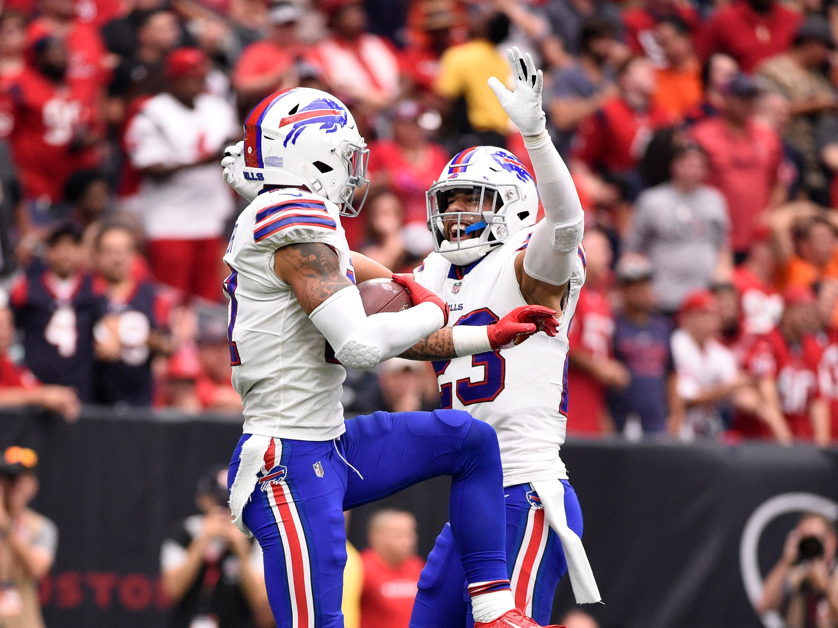 Buffalo Bills free safety Jordan Poyer, left, celebrates his interception with teammate Micah Hyde, right, during the first half of an NFL football game, Sunday, Oct. 14, 2018, in Houston. (AP Photo/Eric Christian Smith)