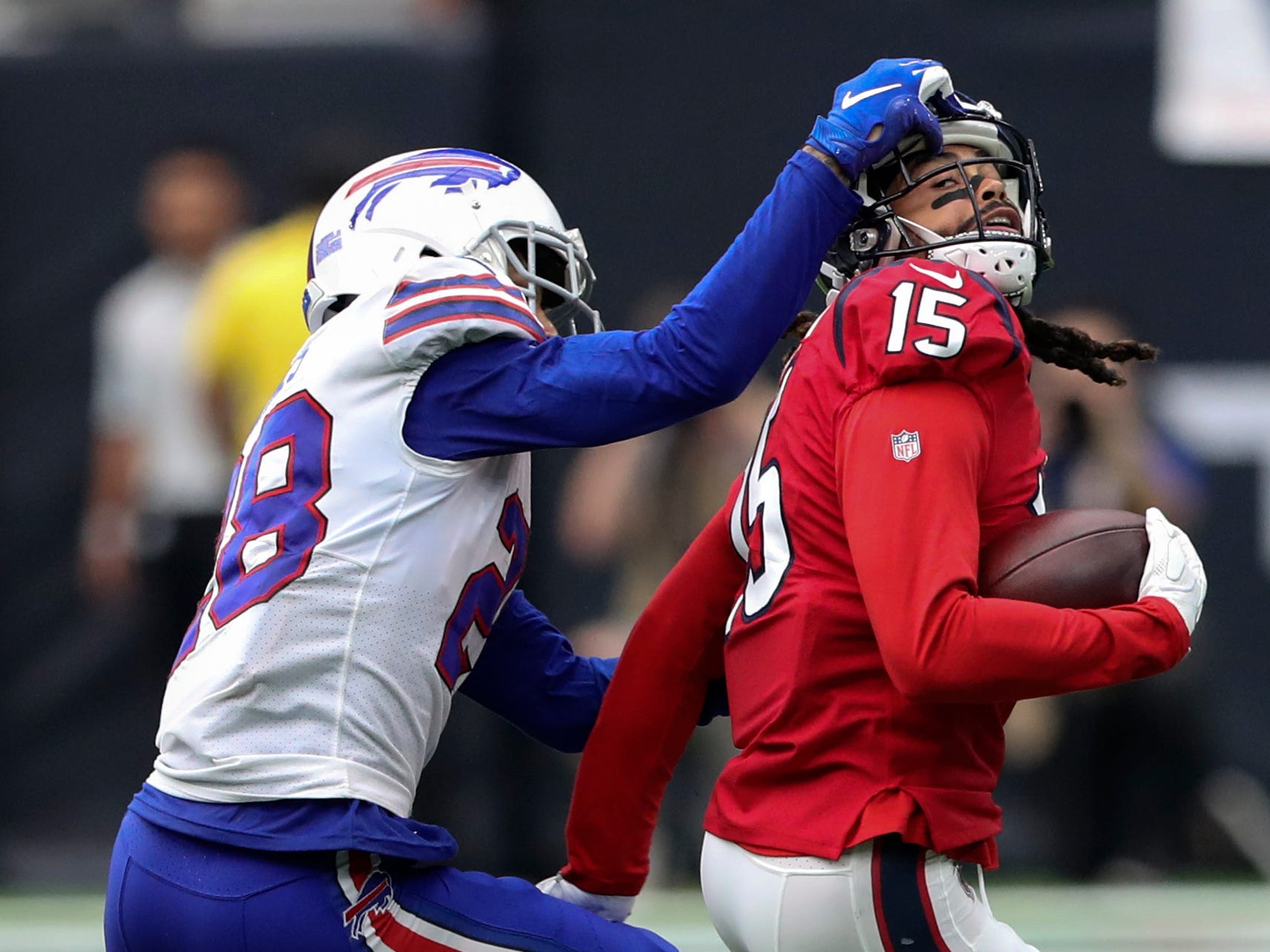 Oct 14, 2018; Houston, TX, USA; Buffalo Bills defensive back Phillip Gaines (28) tackles Houston Texans wide receiver Will Fuller (15) during the second half at NRG Stadium. Mandatory Credit: Kevin Jairaj-USA TODAY Sports