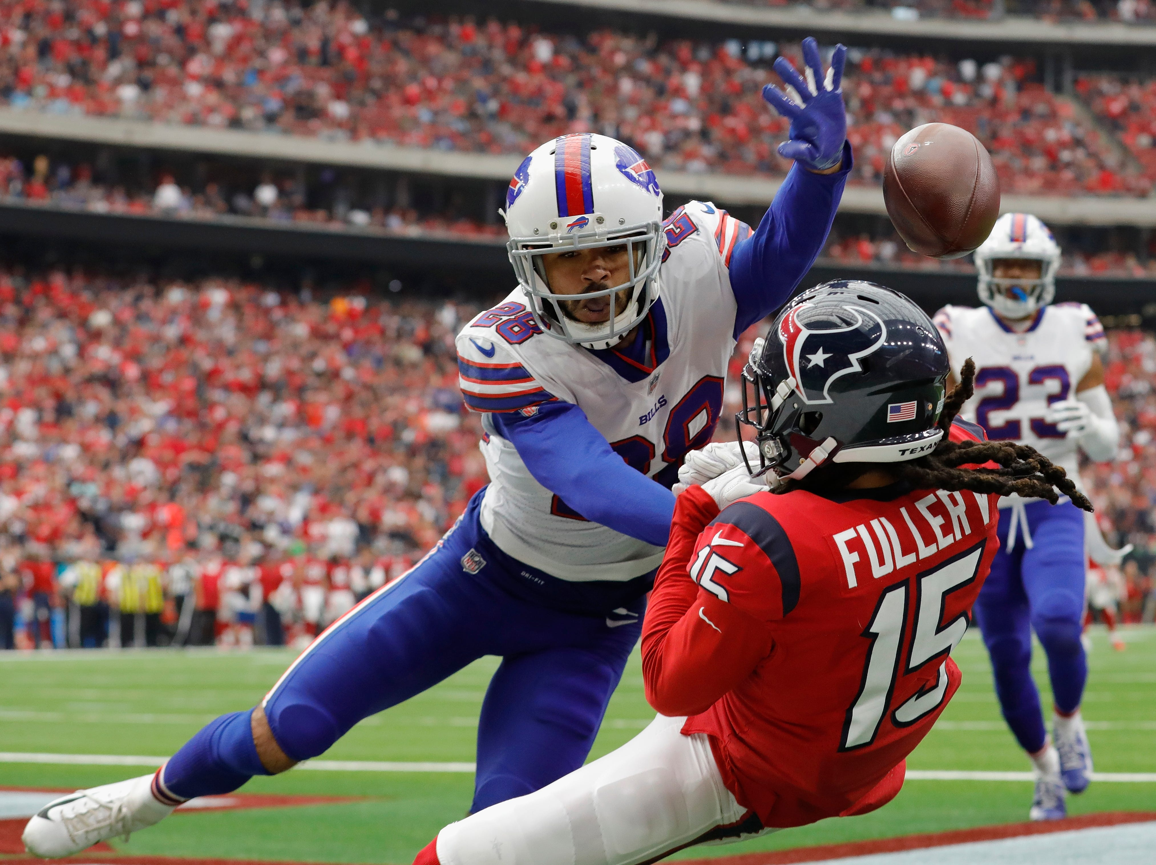 HOUSTON, TX - OCTOBER 14:  Phillip Gaines #28 of the Buffalo Bills is called for interference on Will Fuller #15 of the Houston Texans in the endzone in the fourth quarter at NRG Stadium on October 14, 2018 in Houston, Texas.  (Photo by Tim Warner/Getty Images)