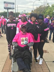 Team Kharlene was walking in memory of Kharlene Johnson, who died in 2016 at the age of 42. Maria Sutton, her mother, seated, is her Johnson's mother and a two-time cancer survivor.