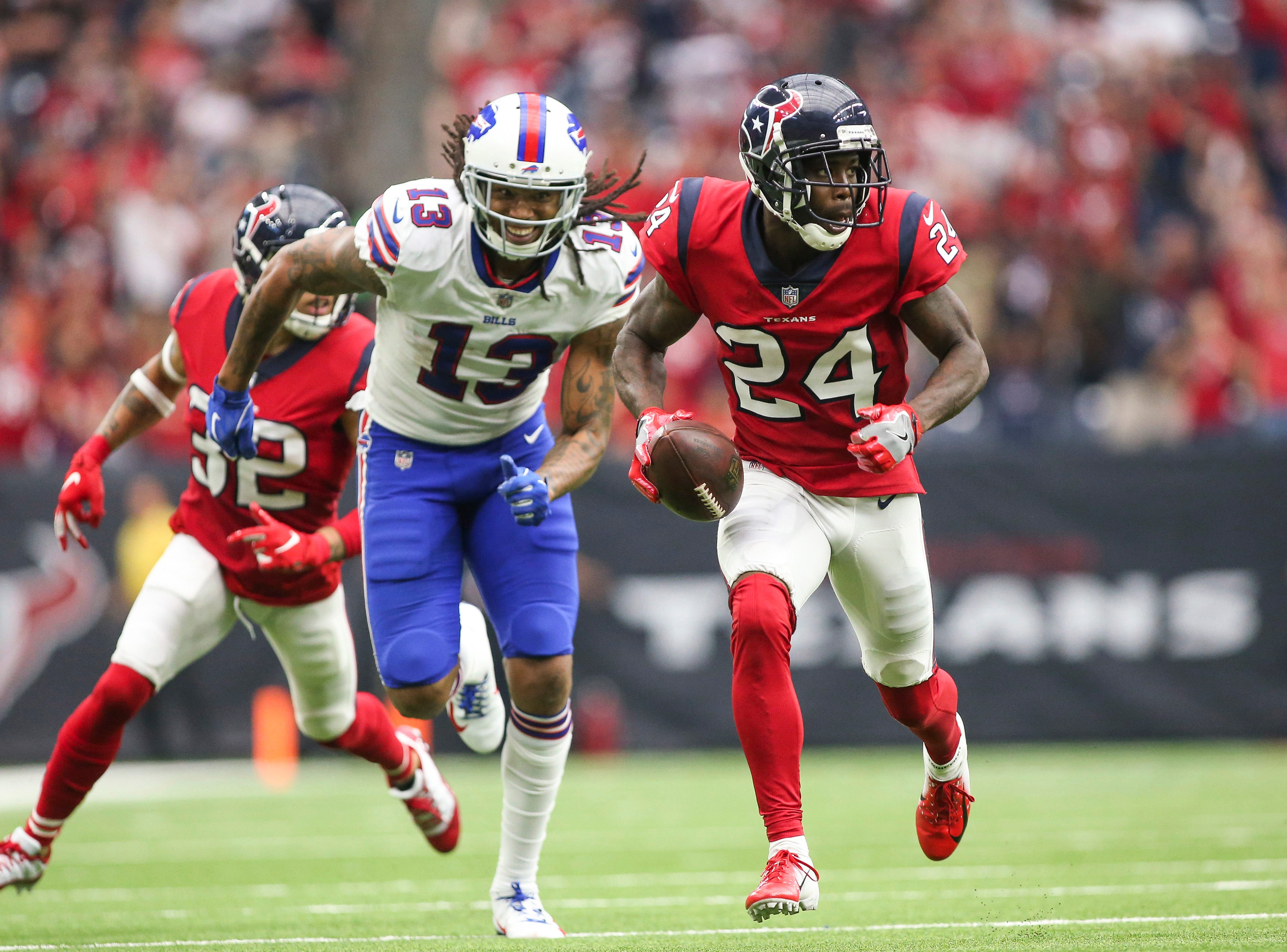 Oct 14, 2018; Houston, TX, USA; Houston Texans cornerback Johnathan Joseph (24) returns an interception for a touchdown during the fourth quarter against Buffalo Bills wide receiver Kelvin Benjamin (13) at NRG Stadium. Mandatory Credit: Troy Taormina-USA TODAY Sports