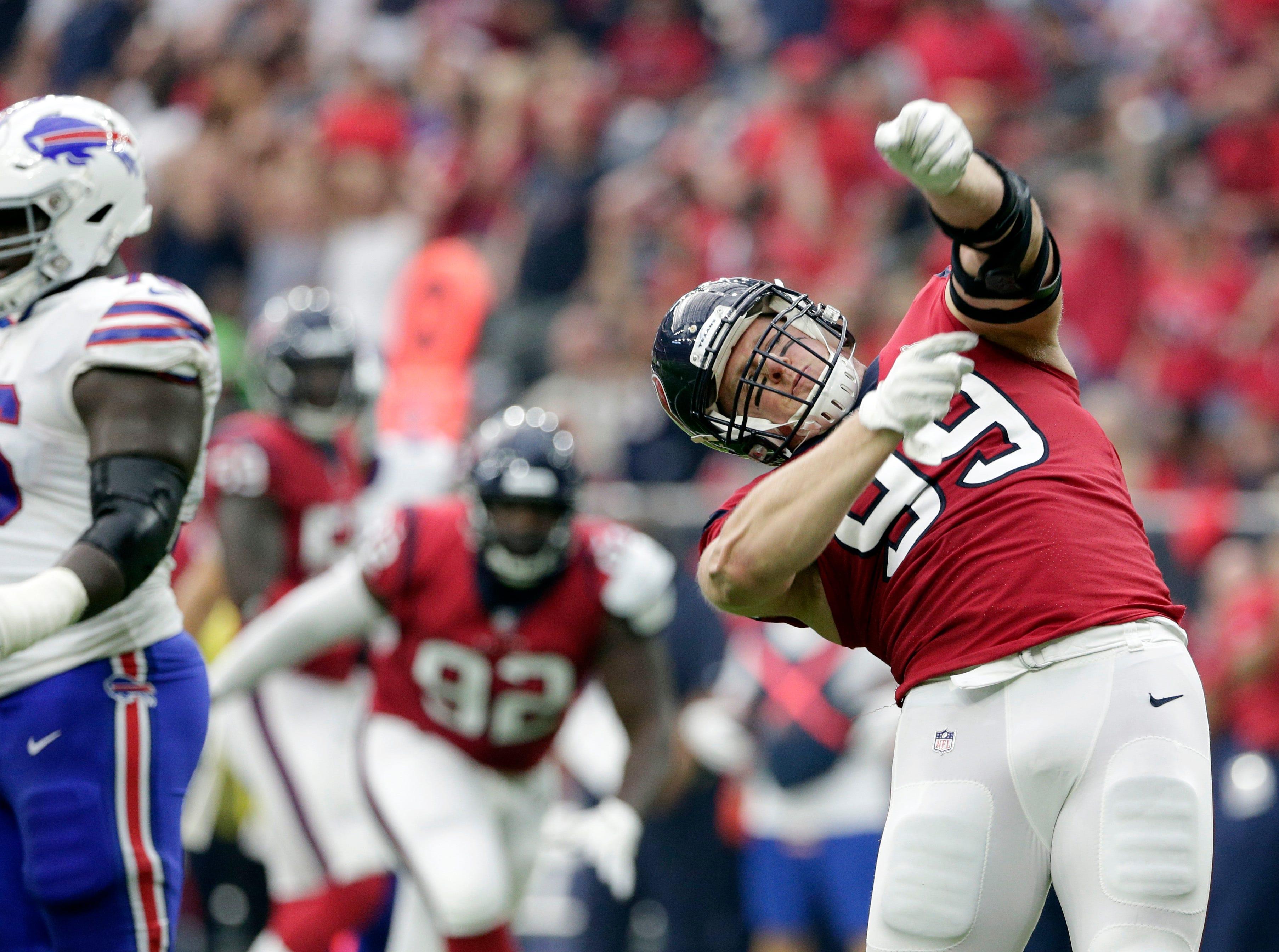 Houston Texans defensive end J.J. Watt (99) celebrates after he sacked Buffalo Bills quarterback Josh Allen during the first half of an NFL football game, Sunday, Oct. 14, 2018, in Houston. (AP Photo/Michael Wyke)