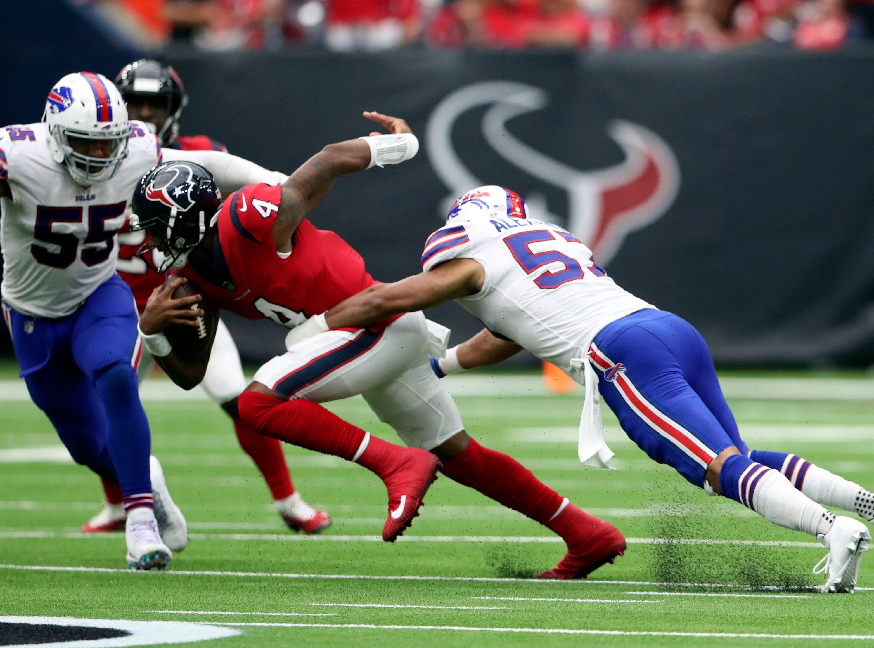 Oct 14, 2018; Houston, TX, USA; Houston Texans quarterback Deshaun Watson (4) is sacked by Buffalo Bills linebacker Lorenzo Alexander (57) during the second half at NRG Stadium. Mandatory Credit: Kevin Jairaj-USA TODAY Sports