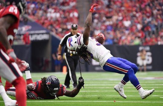 Houston Texans linebacker Jadeveon Clowney (90) pulls Buffalo Bills running back Chris Ivory (33) down by his dreadlocks during the second half of an NFL football game, Sunday, Oct. 14, 2018, in Houston. (AP Photo/Eric Christian Smith)