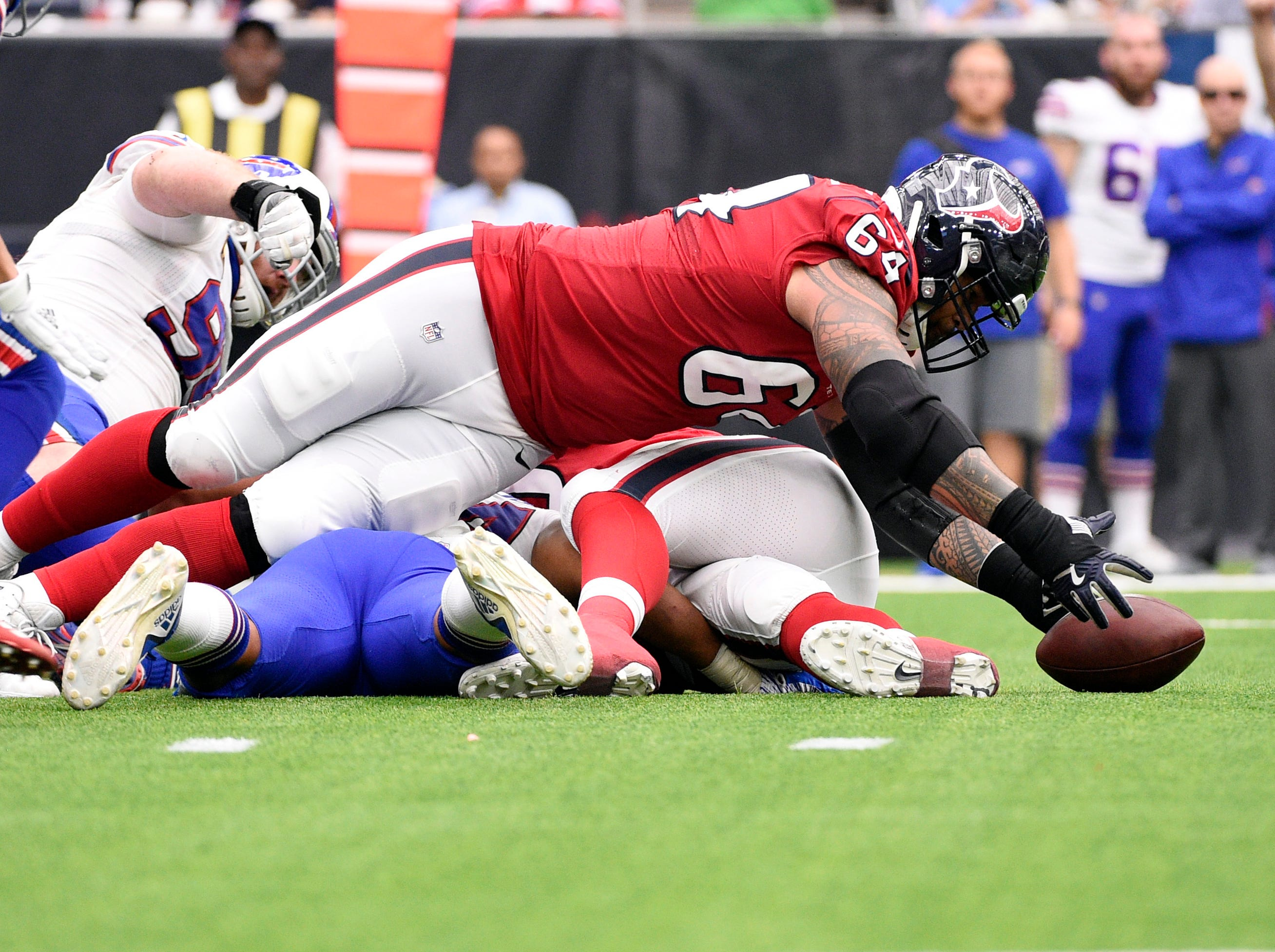 Houston Texans offensive guard Senio Kelemete (64) recovers a fumble during the first half of an NFL football game against the Buffalo Bills, Sunday, Oct. 14, 2018, in Houston. (AP Photo/Eric Christian Smith)