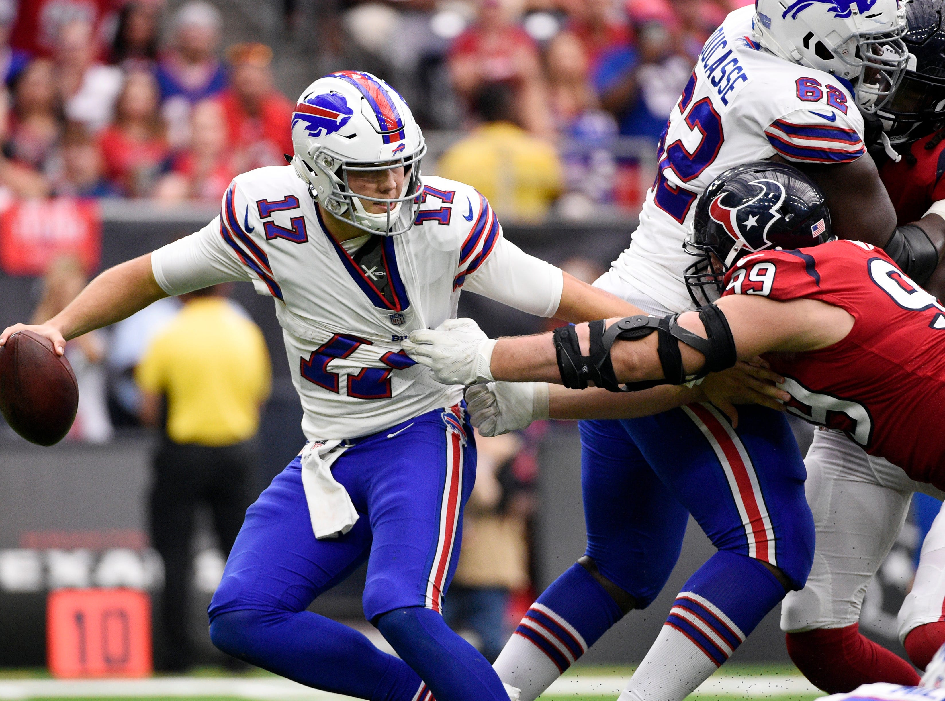 Buffalo Bills quarterback Josh Allen (17) is wrapped up by Houston Texans defensive end J.J. Watt (99) during the second half of an NFL football game, Sunday, Oct. 14, 2018, in Houston. (AP Photo/Eric Christian Smith)