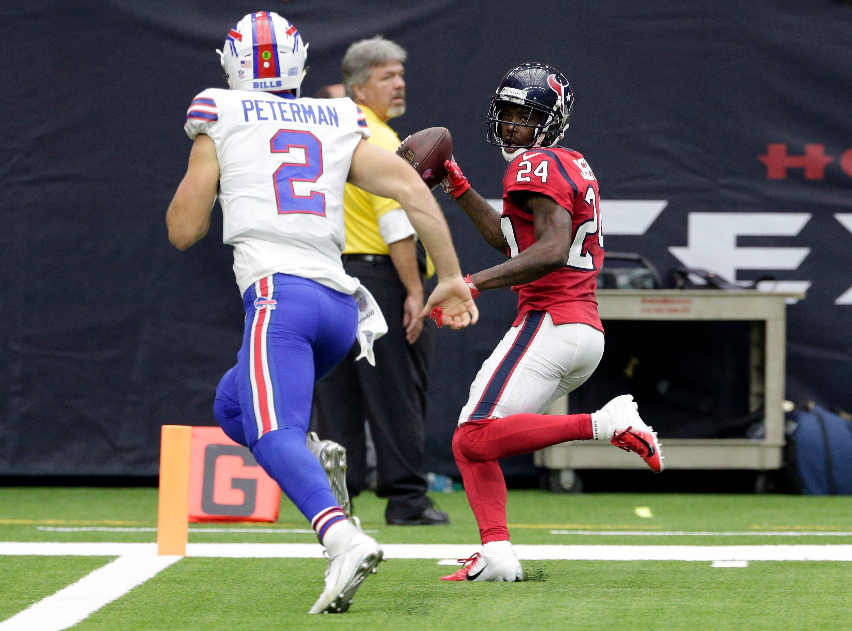 Houston Texans cornerback Johnathan Joseph (24) scores pass Buffalo Bills quarterback Nathan Peterman (2) after intercepting Peterman's pass during the second half of an NFL football game, Sunday, Oct. 14, 2018, in Houston. (AP Photo/Michael Wyke)