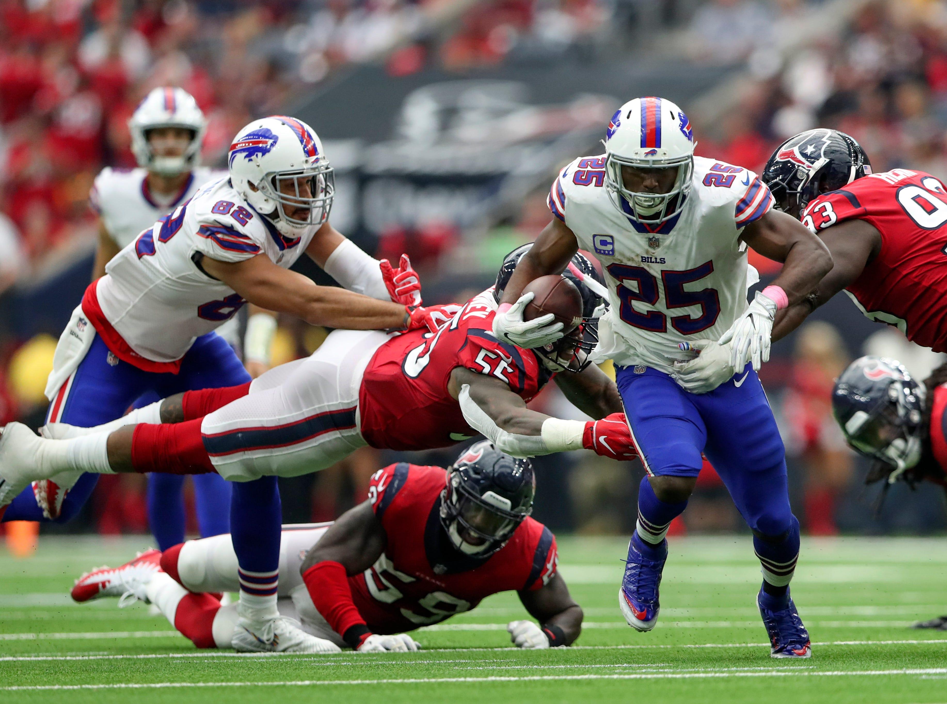 Oct 14, 2018; Houston, TX, USA; Buffalo Bills running back LeSean McCoy (25) runs as Houston Texans linebacker Benardrick McKinney (55) and linebacker Whitney Mercilus (59) defend during the second half at NRG Stadium. Mandatory Credit: Kevin Jairaj-USA TODAY Sports