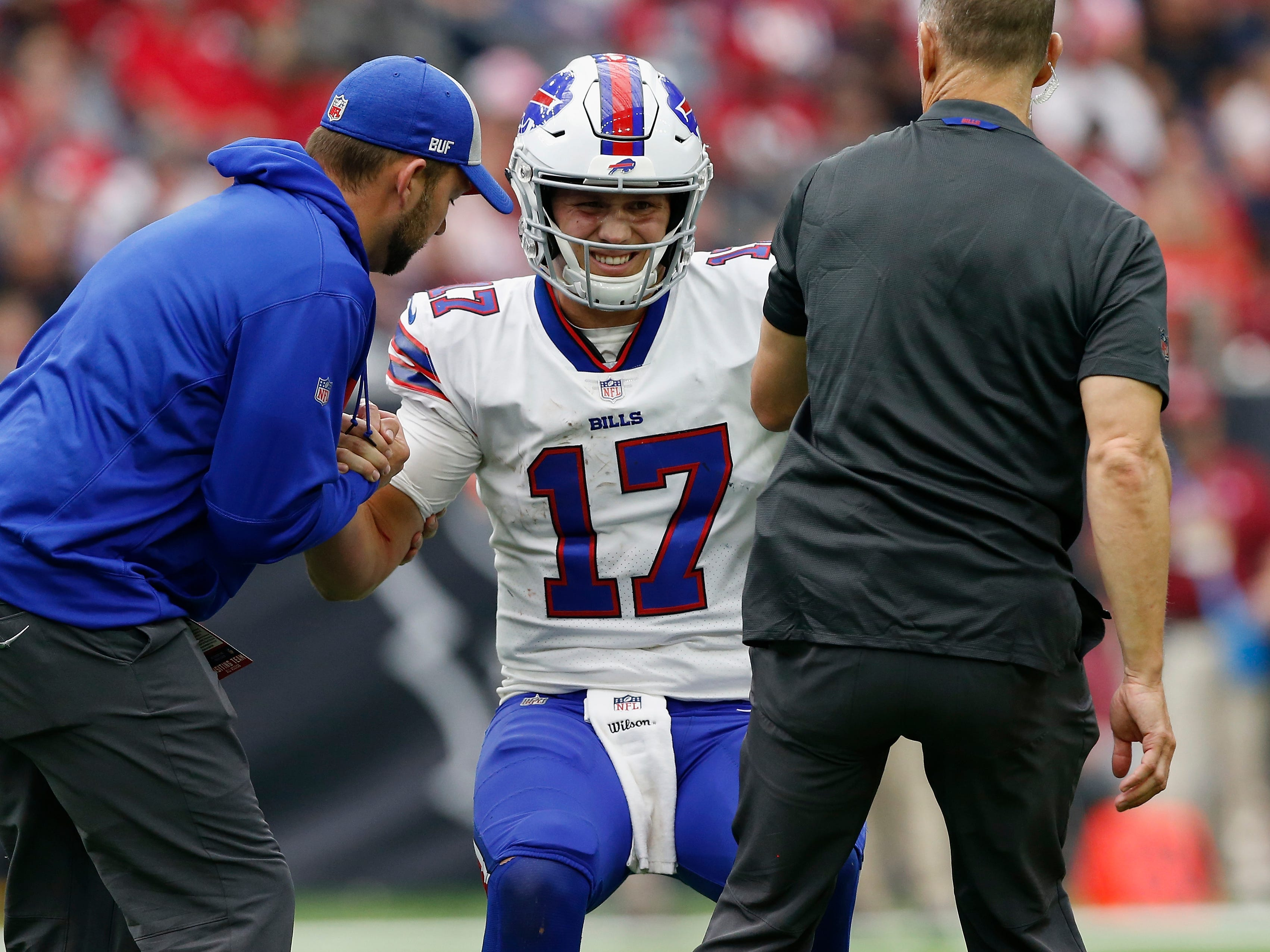 Training staffers tend to Buffalo Bills quarterback Josh Allen after he suffered an elbow injury in the second half of Sunday's loss to the Houston Texans.