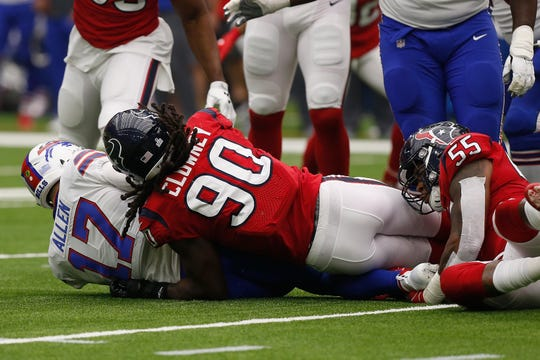 HOUSTON, TX - OCTOBER 14:  Jadeveon Clowney of the Houston Texans sacks Josh Allen of the Buffalo Bills in the second quarter at NRG Stadium on October 14, 2018, in Houston, Texas.  (Photo by Bob Levey/Getty Images)