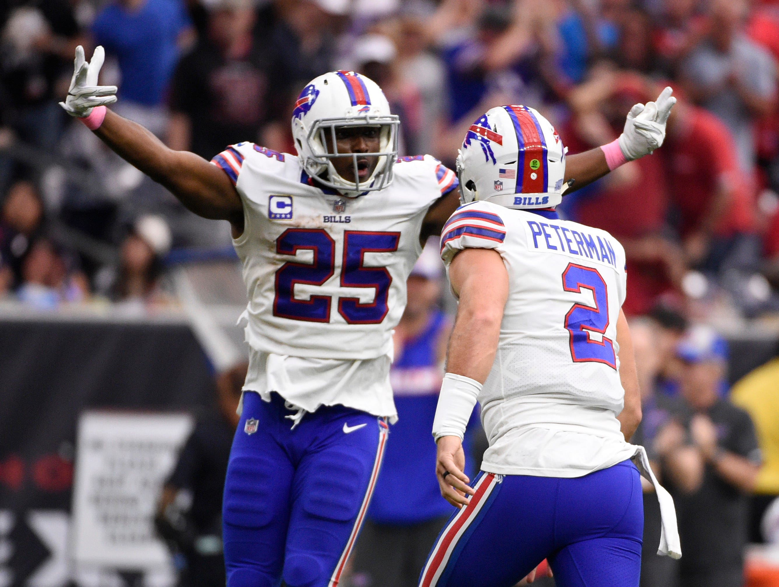 Buffalo Bills quarterback Nathan Peterman (2) celebrates his touchdown pass against the Houston Texans with teammate LeSean McCoy (25) during the second half of an NFL football game, Sunday, Oct. 14, 2018, in Houston. (AP Photo/Eric Christian Smith)