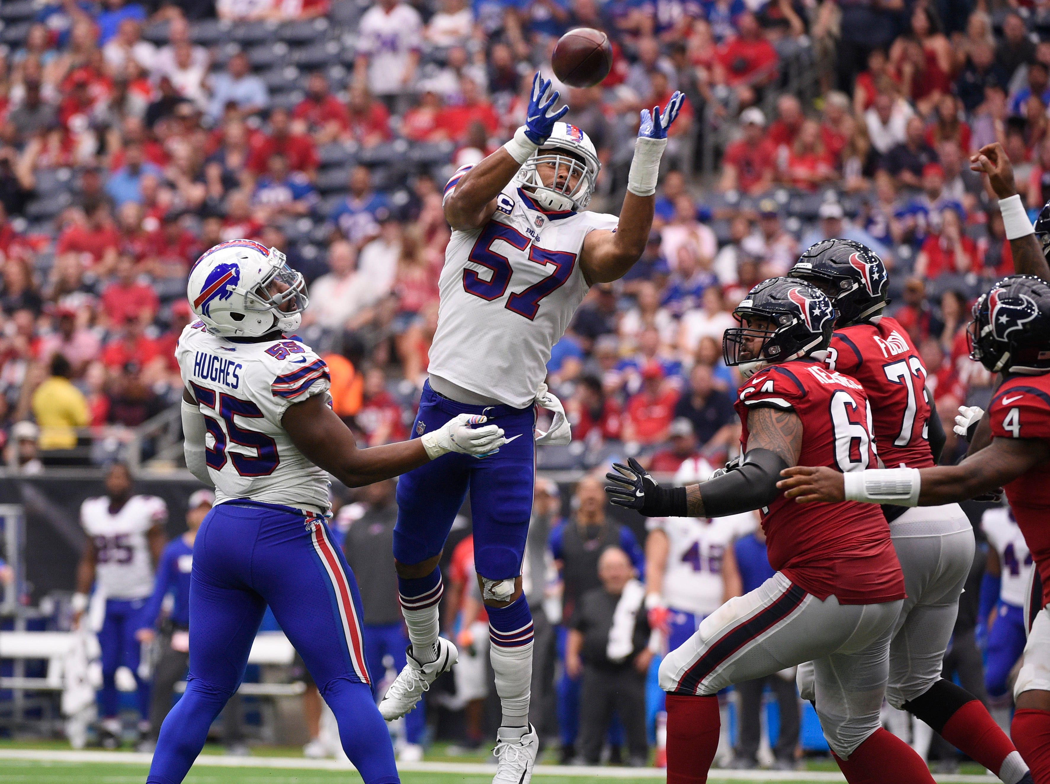 Buffalo Bills linebacker Lorenzo Alexander (57) intercepts a pass against the Houston Texans during the first quarter of an NFL football game, Sunday, Oct. 14, 2018, in Houston. (AP Photo/Eric Christian Smith)