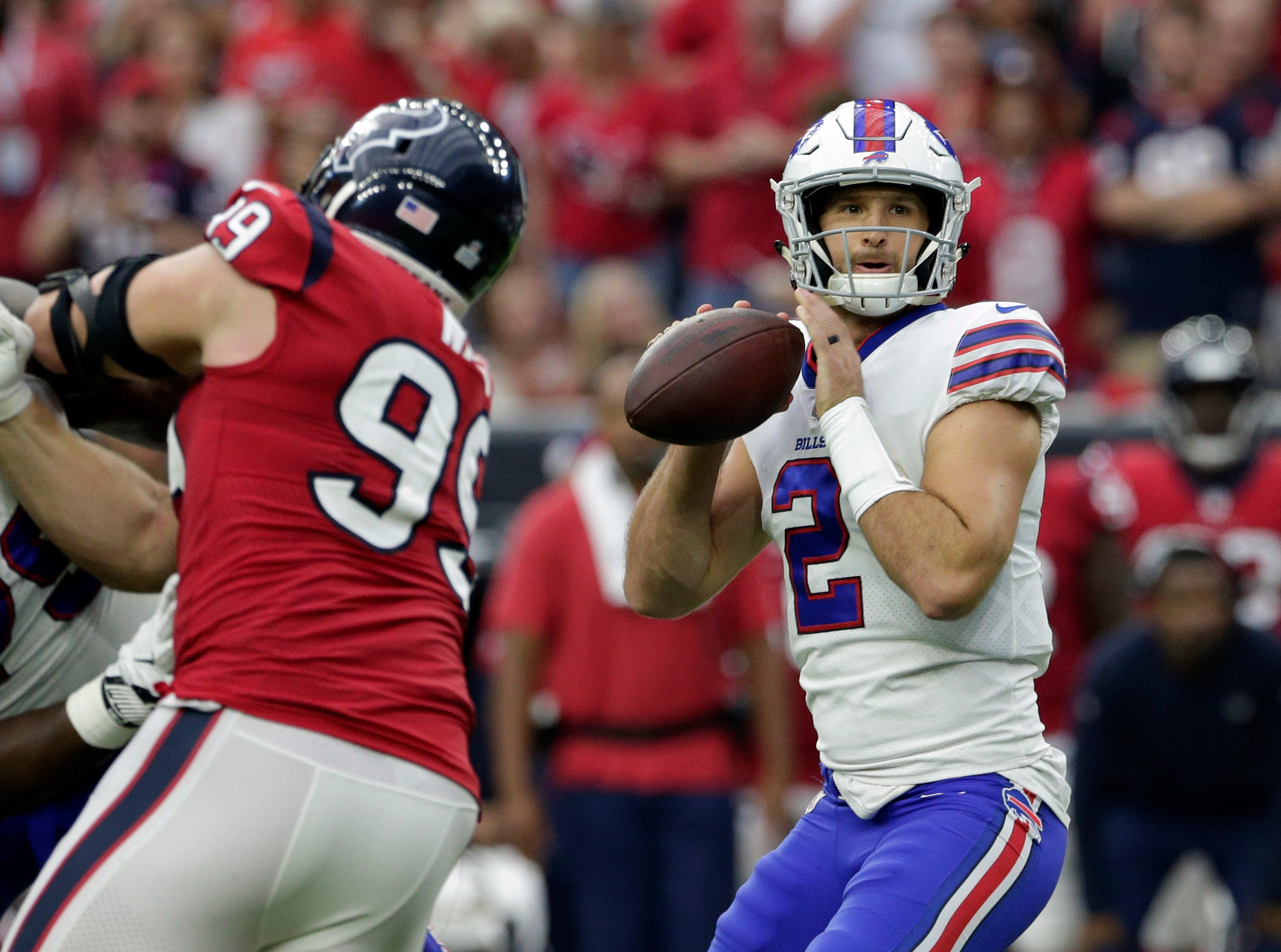 Buffalo Bills quarterback Nathan Peterman (2) looks to throw against the Houston Texans during the second half of an NFL football game, Sunday, Oct. 14, 2018, in Houston. (AP Photo/Michael Wyke)