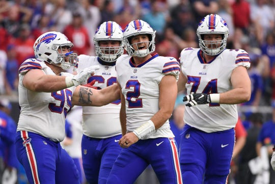 Buffalo Bills quarterback Nathan Peterman (2) celebrates his touchdown pass against the Houston Texans with teammates during the second half of an NFL football game, Sunday, Oct. 14, 2018, in Houston. (AP Photo/Eric Christian Smith)