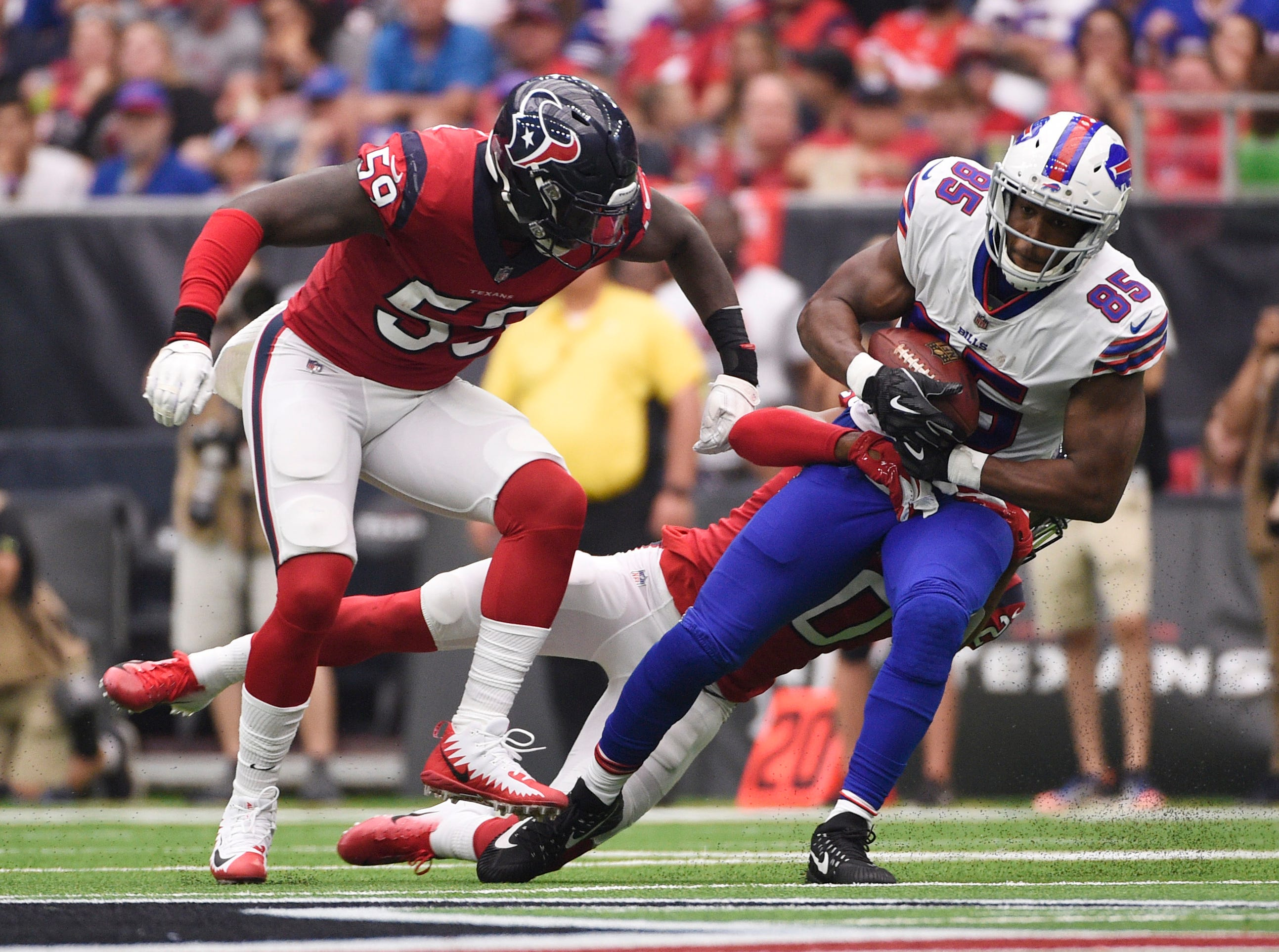Buffalo Bills tight end Charles Clay (85) is hit by Houston Texans defensive back Justin Reid (20) after a catch during the first quarter of an NFL football game, Sunday, Oct. 14, 2018, in Houston. (AP Photo/Eric Christian Smith)