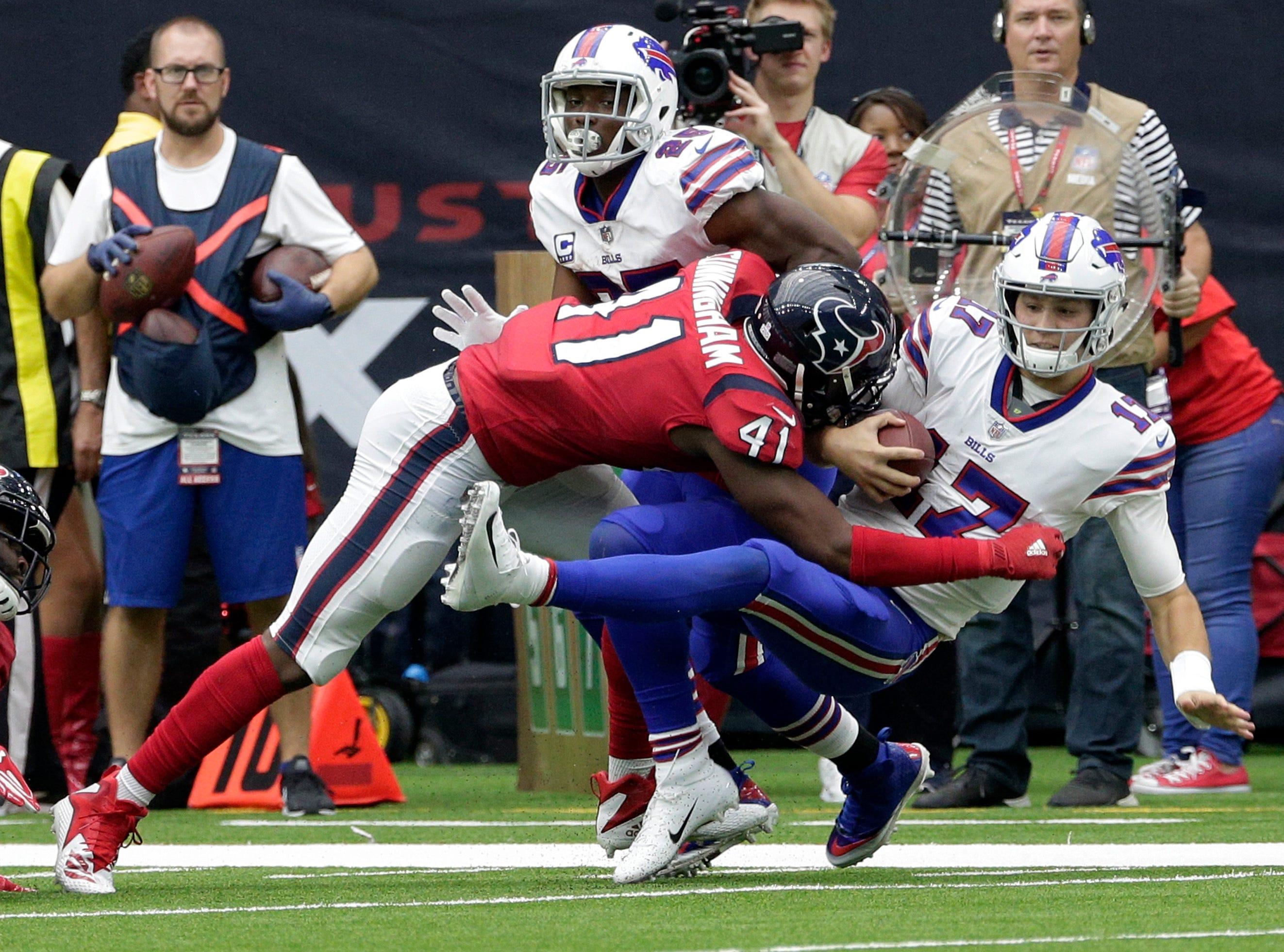 Buffalo Bills quarterback Josh Allen (17) is hit by Houston Texans linebacker Zach Cunningham (41) during the second half of an NFL football game, Sunday, Oct. 14, 2018, in Houston. (AP Photo/Michael Wyke)
