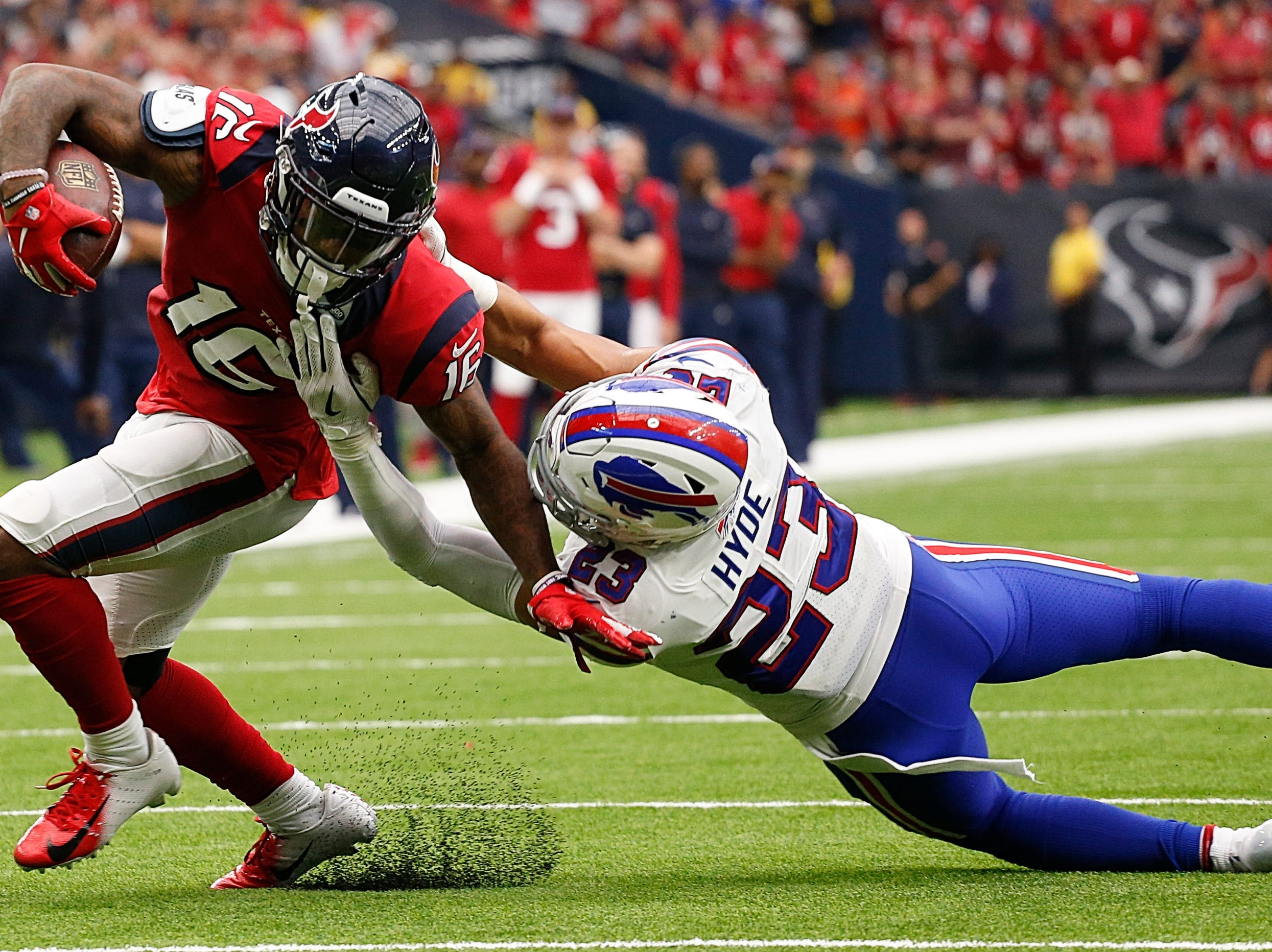 HOUSTON, TX - OCTOBER 14:  Keke Coutee #16 of the Houston Texans is tackled by Micah Hyde #23 of the Buffalo Bills in the second half at NRG Stadium on October 14, 2018 in Houston, Texas.  (Photo by Bob Levey/Getty Images)
