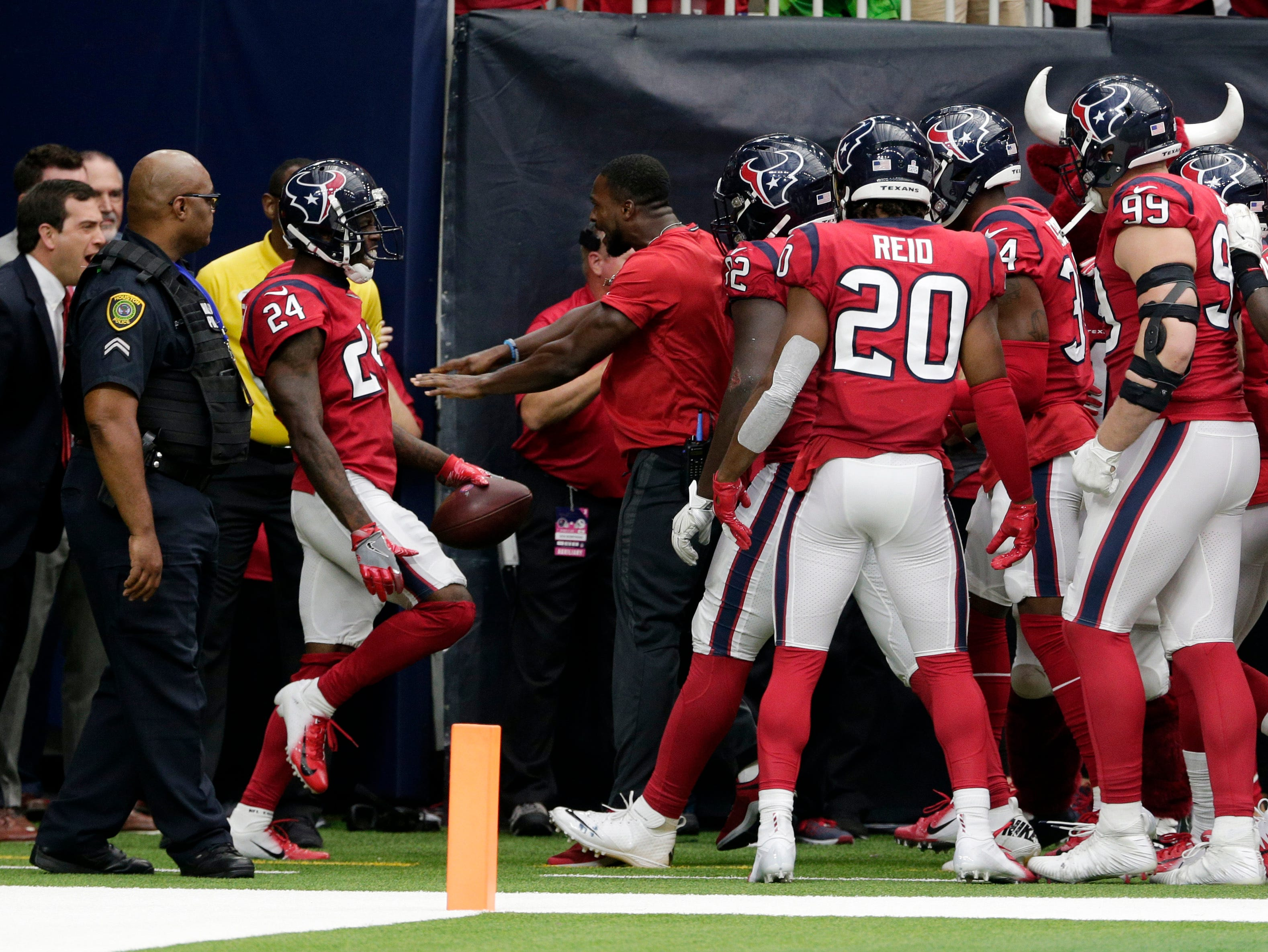 Houston Texans cornerback Johnathan Joseph (24) celebrates with teammates after he ran back an interception for a touchdown against the Buffalo Bills during the second half of an NFL football game, Sunday, Oct. 14, 2018, in Houston. (AP Photo/Michael Wyke)