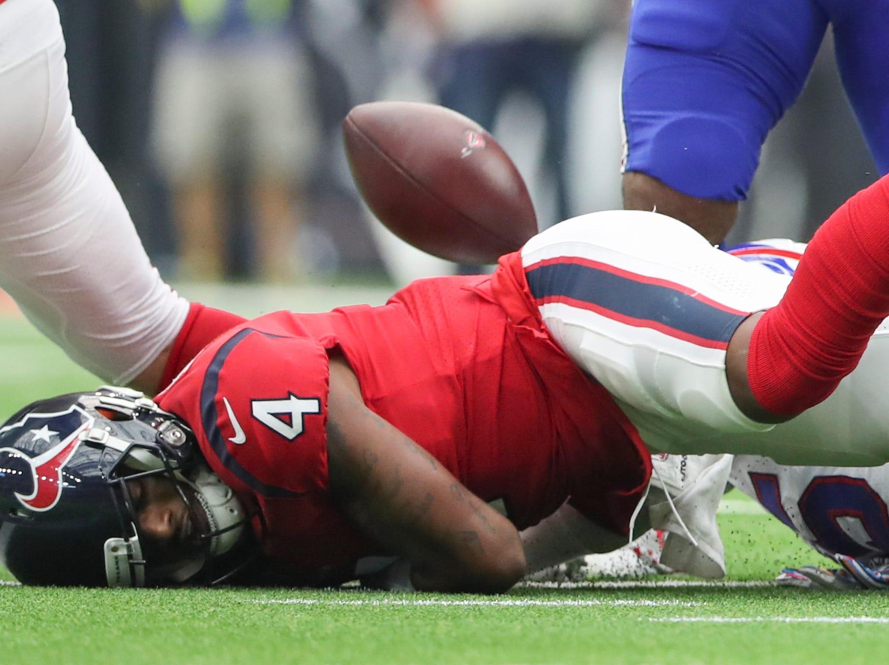 Oct 14, 2018; Houston, TX, USA; Houston Texans quarterback Deshaun Watson (4) fumbles during the second half against the Buffalo Bills at NRG Stadium. Mandatory Credit: Kevin Jairaj-USA TODAY Sports