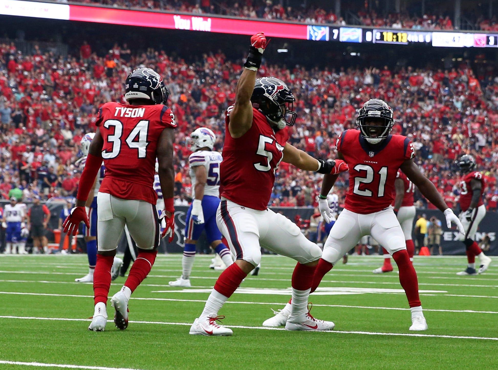 Oct 14, 2018; Houston, TX, USA; Houston Texans linebacker Brennan Scarlett (57) celebrates with teammates after blocking a punt during the second quarter against the Buffalo Bills at NRG Stadium. Mandatory Credit: Kevin Jairaj-USA TODAY Sports
