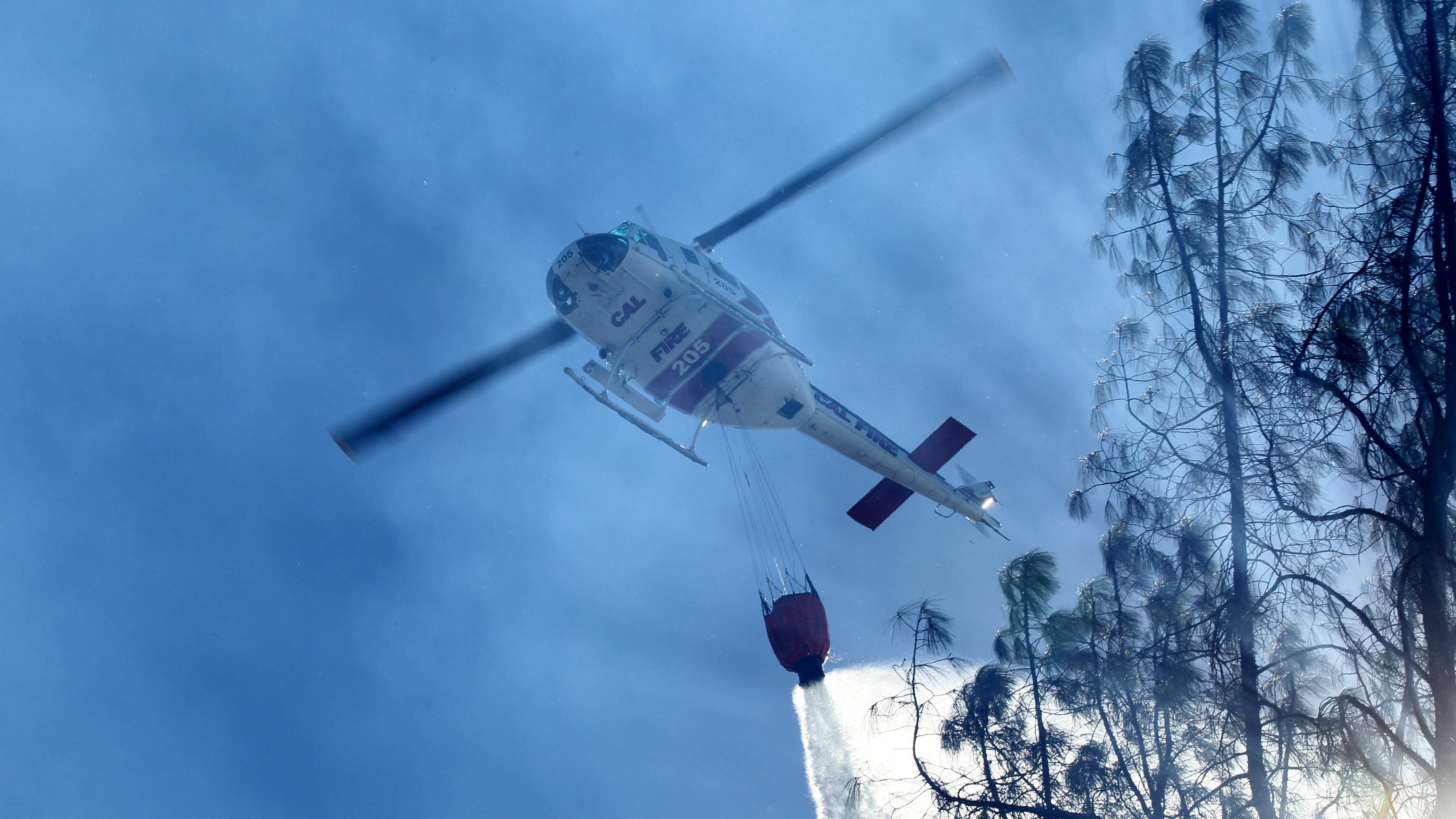 A Cal Fire helicopter drops water on the Masonic Fire as it burns vegetation along Sulphur Creek Road on Sunday morning, Oct. 14, 2018. (Hung T. Vu/Special to the Record Searchlight)
