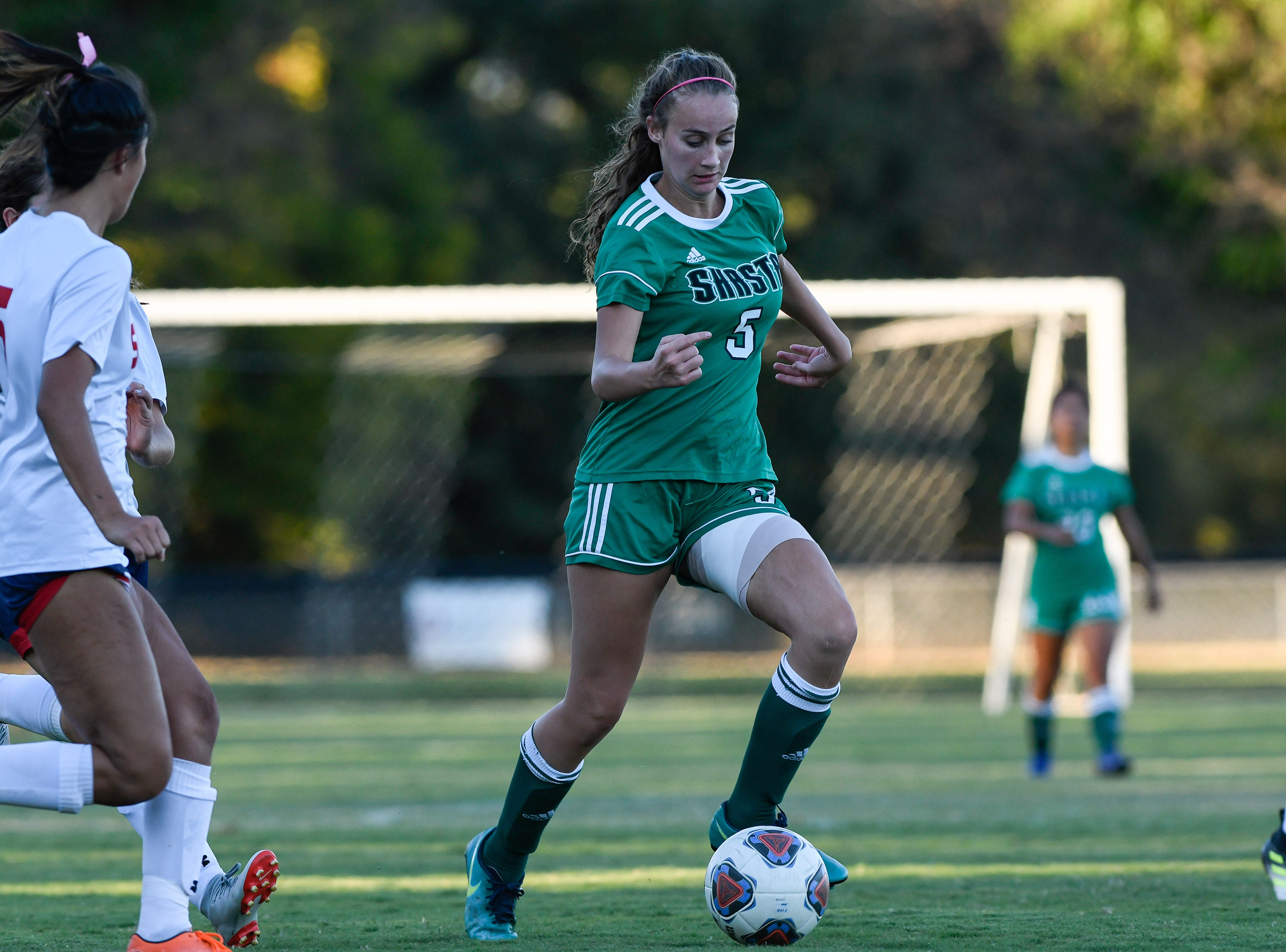 Jenna Monahan runs with the ball during the Knights' 1-1 tie against College of the Siskiyous on Friday, Oct. 12, 2018.