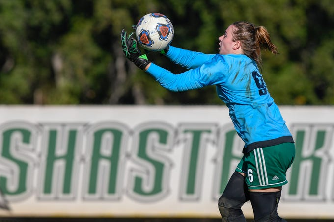 Shasta College goalie and Anderson grad Bethany Sather holds the ball during the Knights' 1-1 tie against College of the Siskiyous on Friday, Oct. 12, 2018.