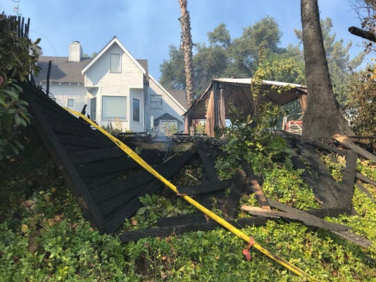 A fence, palm tree and cabana got scorched by the Masonic Fire on Sunday, Oct. 14, 2018.